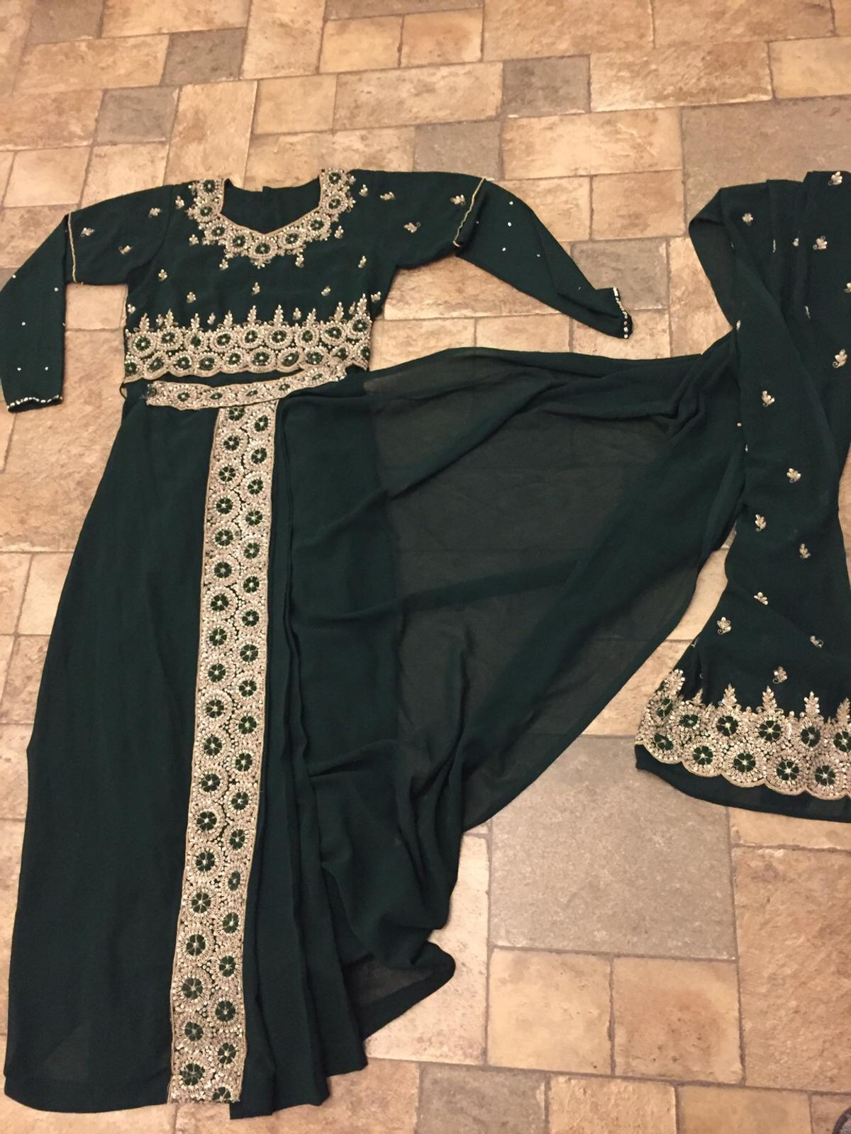 tunning Asian Indian Fancy Sari  Full sleeves blouse  Size medium  measurements:  sari length: 39 inches Approx  blouse length: 24 inches Approx  chest : 36 inches Approx ( front and back)  sleeves: 28 inches Approx  Only used twice. In excellent condition