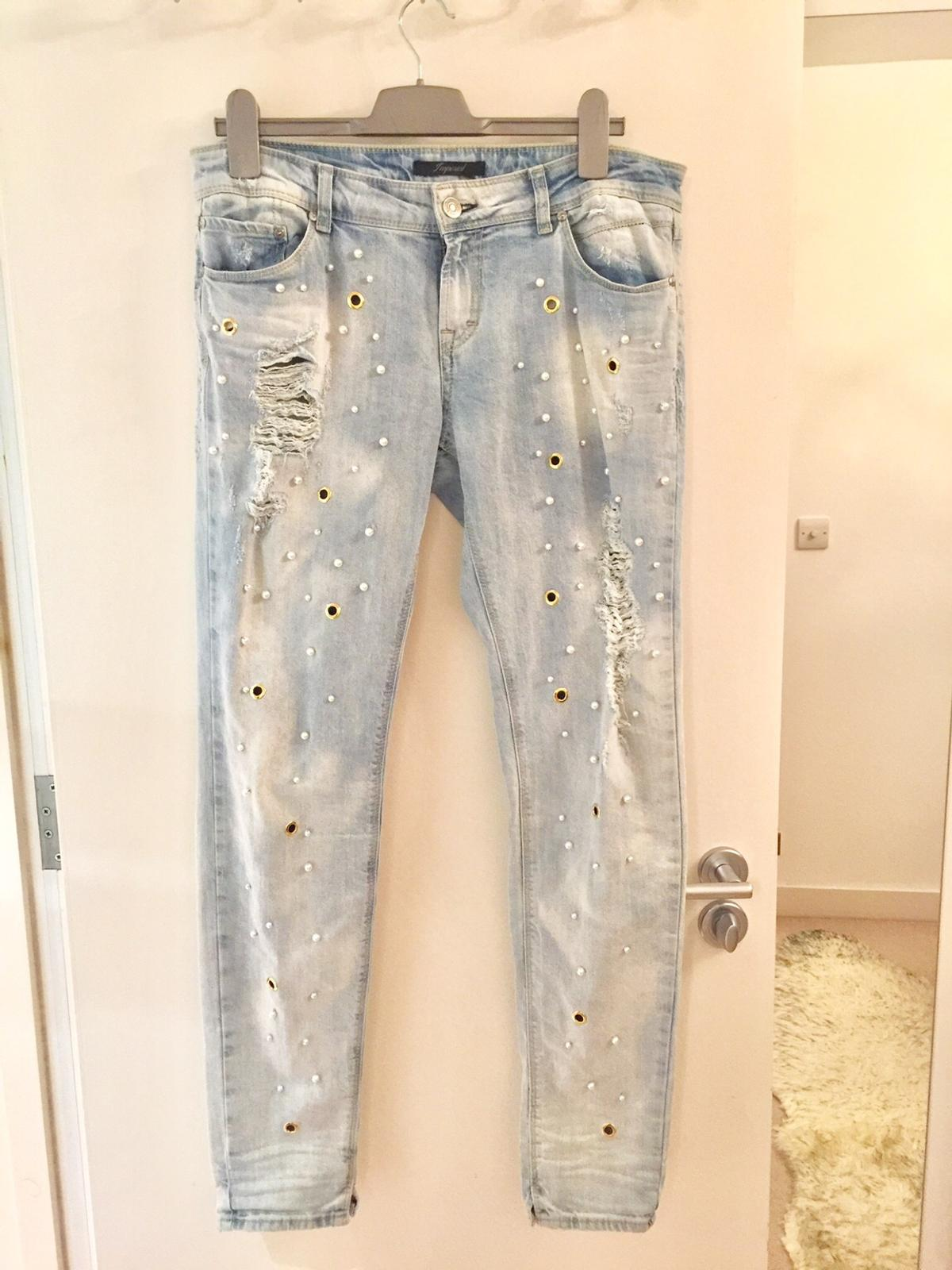 Beautiful colour distressed Italian jeans Decorated with pearls Size Medium/large Will fit 12-14 uk New without tags Paid £150 in boutique I can dispatch for extra £4 Sensible offers welcome