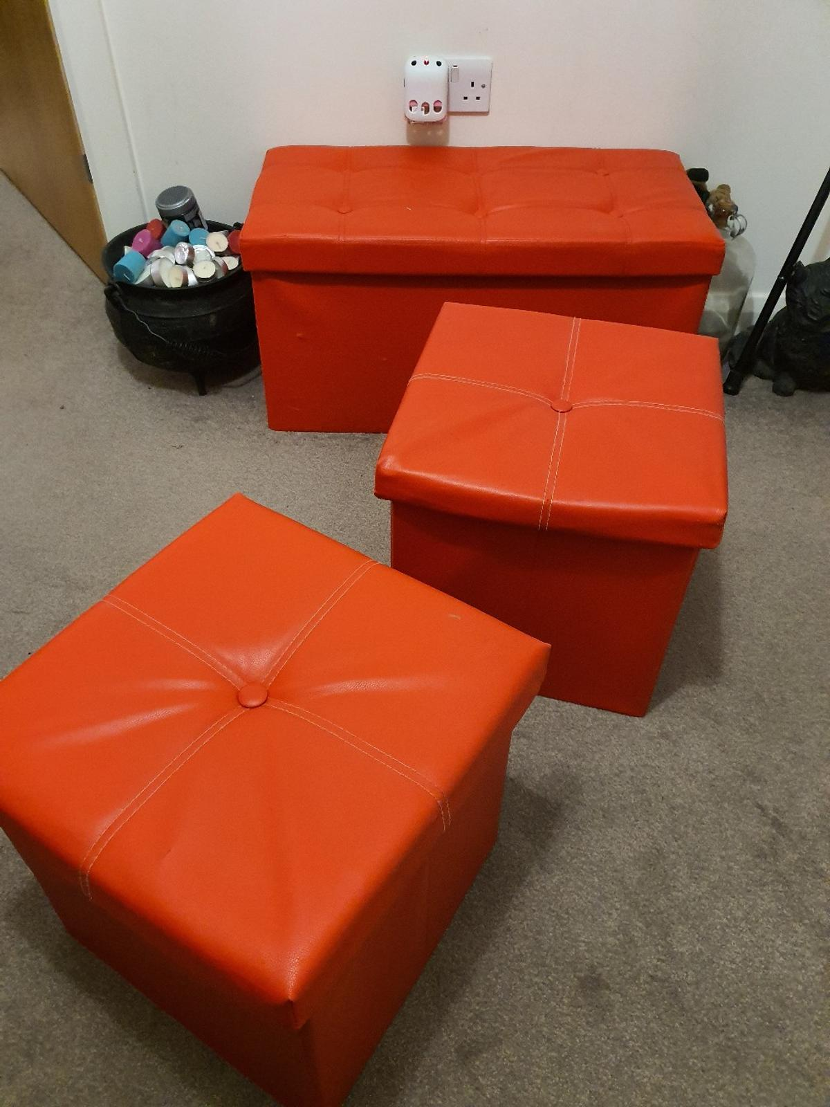 3 Red Storage Boxes can be used for sitting on as well imitation leather sizes small ones 15cmx15cmx15cm large one 29 cm length 37cm width 38 cm height can deliver if local in gravesend