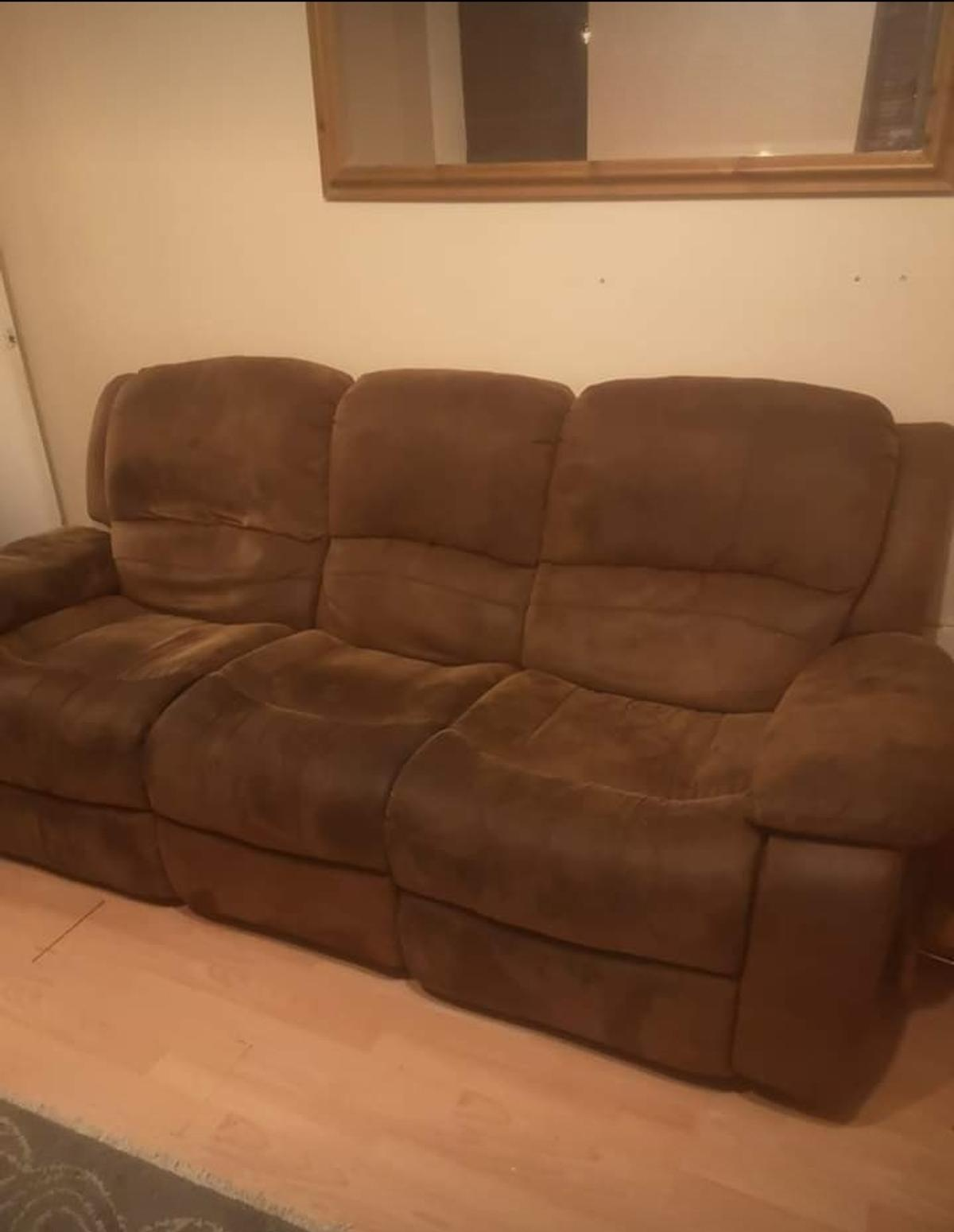 Here for sale I have this Harvey's brown faux suede 3 seater sofa which has manual recliner at both ends.  Item does have scratches/marks/stains/signs of use as expected but still has life left in it. Height 99cm  Width 200cm  Depth 97cm  It does come apart for easy removal.  collection from Peckham  Grab yourself a bargain...need gone by Sunday 12.1.2020