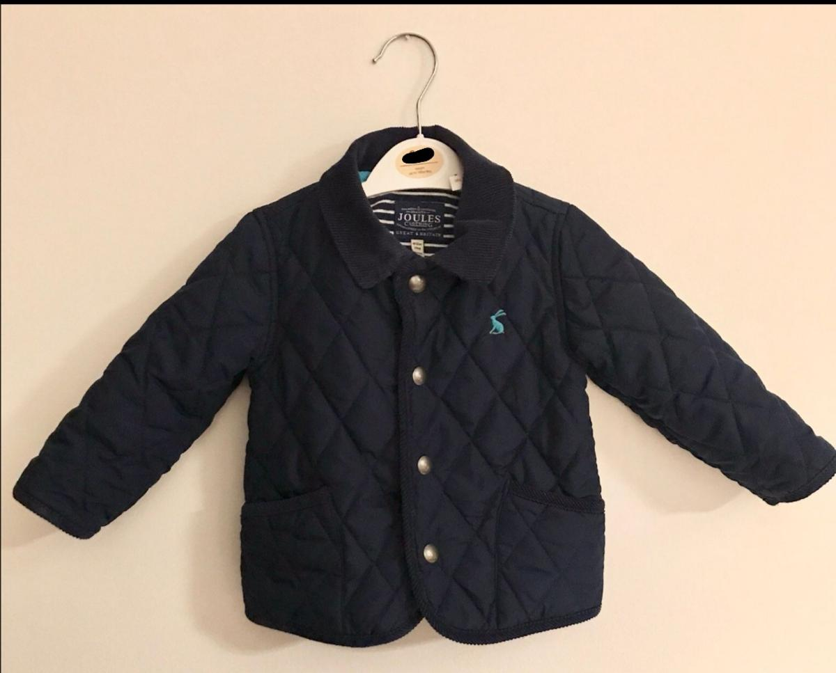 Joules baby coat. Dark blue with sky blue logo. Size 9 to 12 months  Barely worn. From a smoke and pet free home