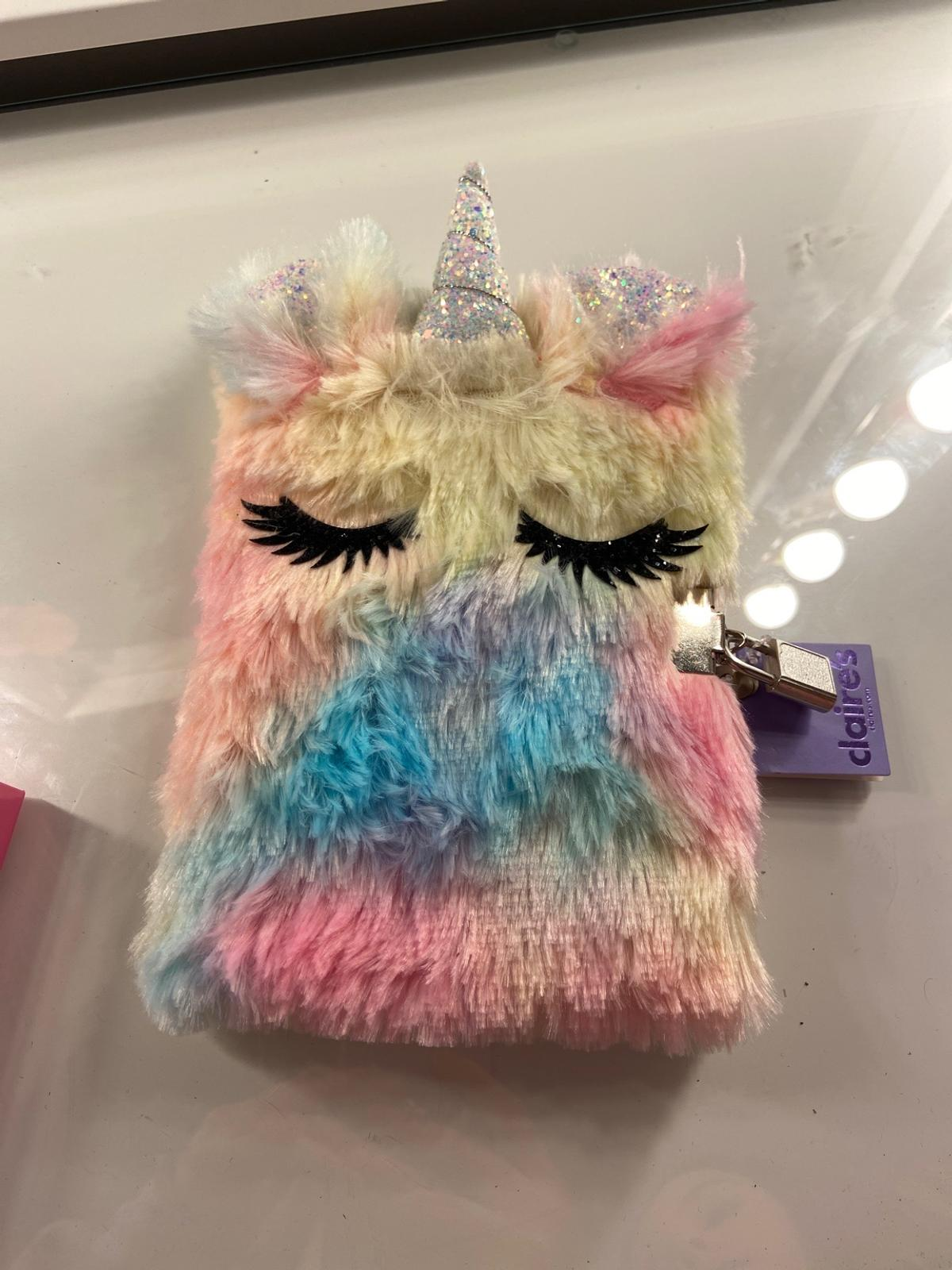 A fluffy unicorn diary with a lock