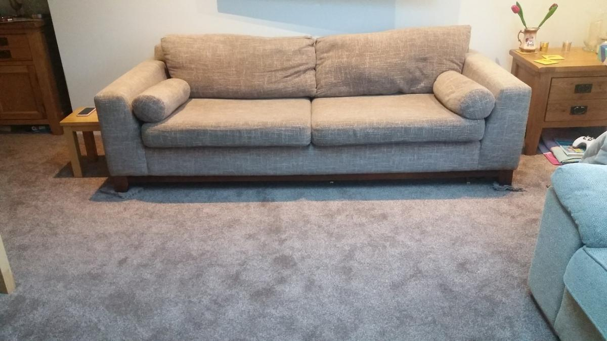 Kim Johnson design large 4 seater sofa. Low back and sides, removable cushions. Woven fabric in beige mix colour. Wooden frame and sprung base. Looks great, comfortable and well made. Approx dimensions: Length: 230 cm, width: 95 cm, height: 68 cm. Pet free, non-smoking home.