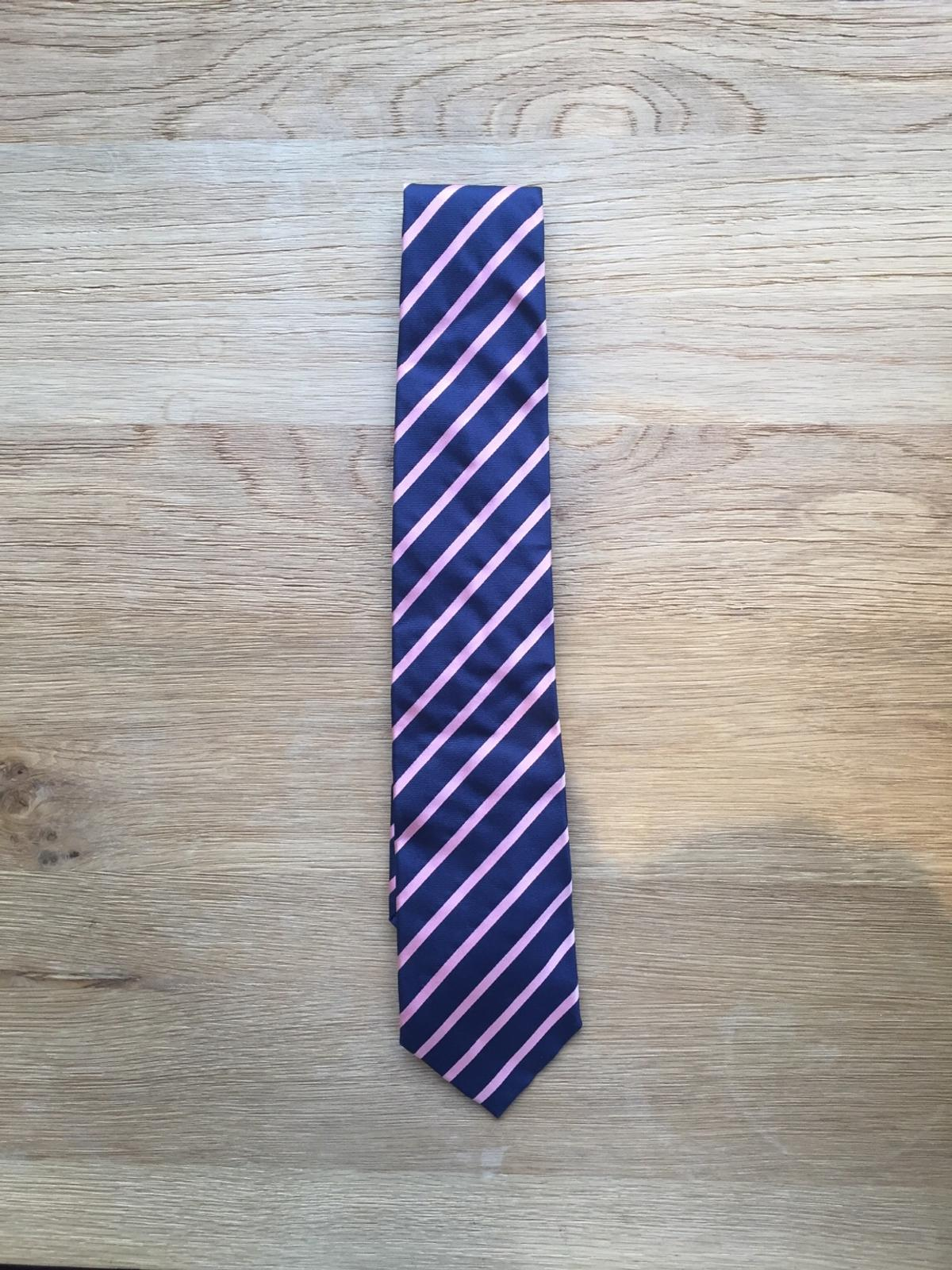 Good condition, hardly worn navy and pink silk striped tie by Paul Smith. Floral lining. Length 145cm