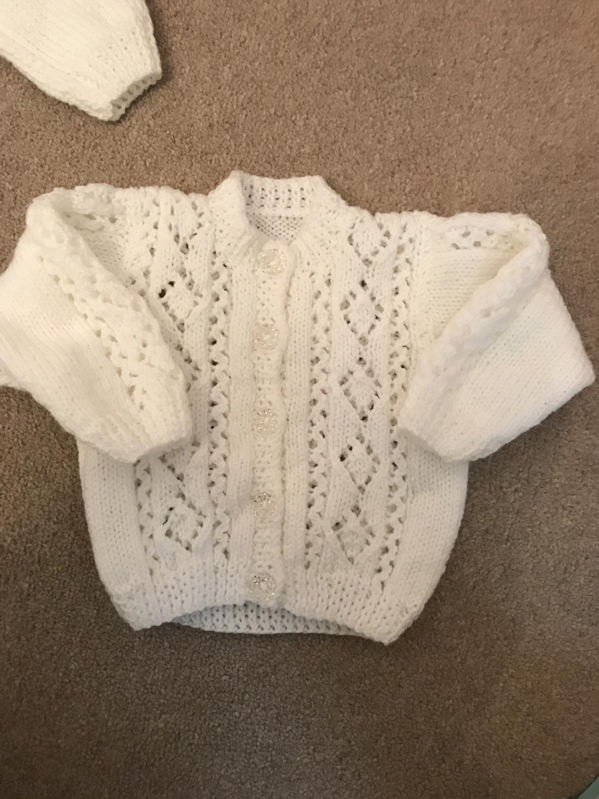 Hand knitted Cardi never worn just washed. Roughly 3-6 month