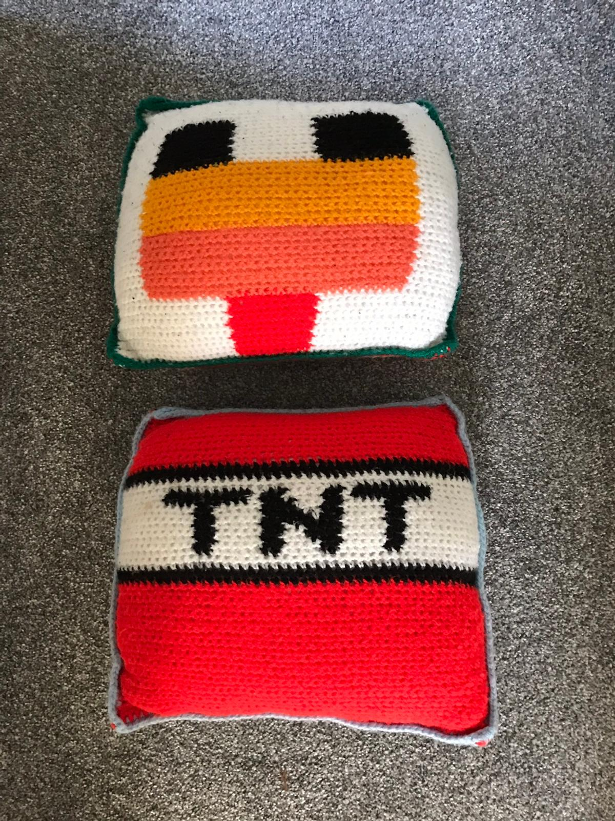 Double sided kitted Minecraft cushions.  Have been stored for a while so will need a freshen up.