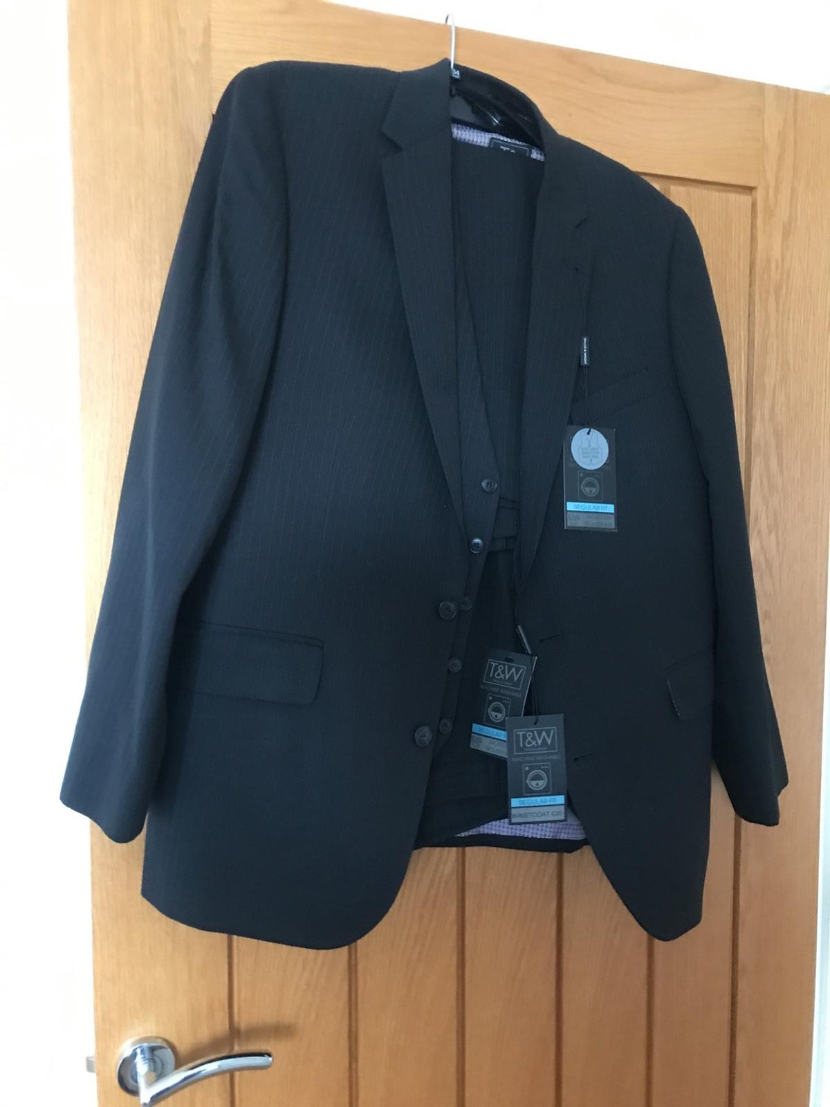 Brand new mans suit never worn still has tags on jacket is42chest as is the waistcoat trousers 34waist 29inside leg