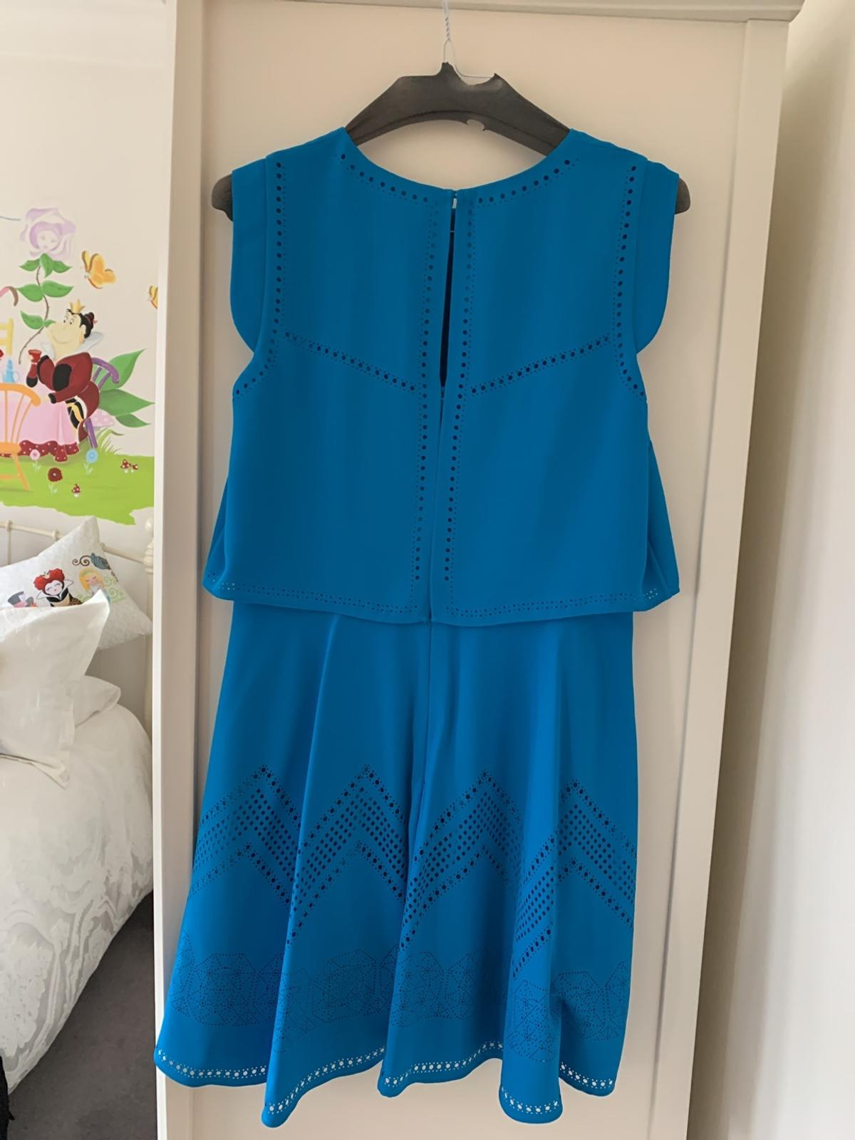 Petrol blue beautiful design and fabric will not disappoint as new condition a real head turner size 14