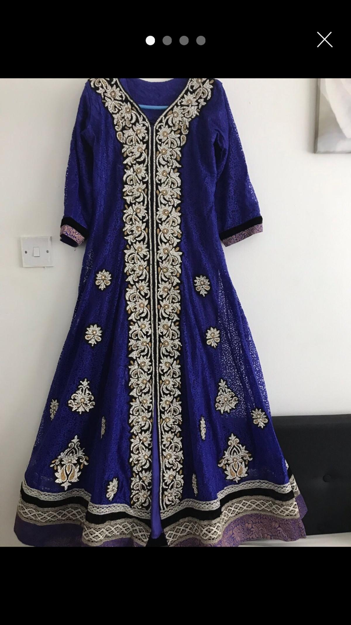 Elegant and detailed diamond work over intricate net. Has simple detailing on the chusti pachama. Bought for over £250 and only worn once. Also available in a small sized maroon colour Size: large