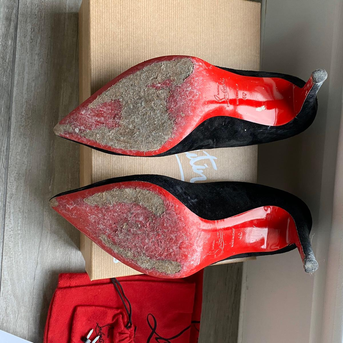 Christian Louboutin suede black heels. Size 7 EU size 40. The stem of the heel is damaged (see image) and they will need to be re-heeled. They come with a new set of heels and as they have the receipt selfridges will reheel them for free. They are in good condition. I'm moving house soo need them gone as soon as possible, please don't waste my time ! I am Open to offers!