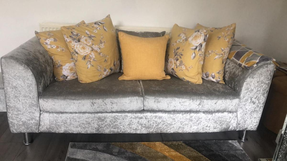 I am selling my 2 x 3 seaters sofas in velvet grey for quick sale as change of room decoration they in mint condition less then a a year old only 6 months old must be seen with the cushions very coffy sofas an wide can take covers of to wash £400 Ono