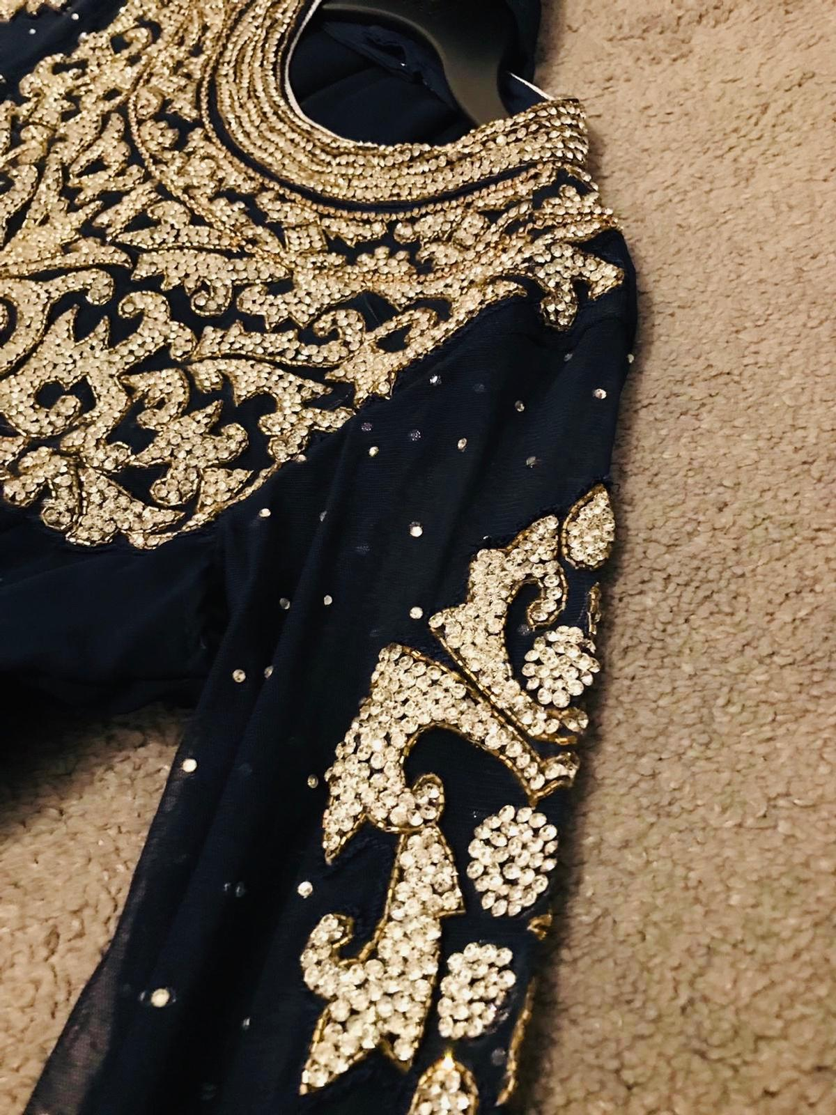 Traditional outfit. Navy. Full Sleeves. Lots of stone work done on the outfit. Size M