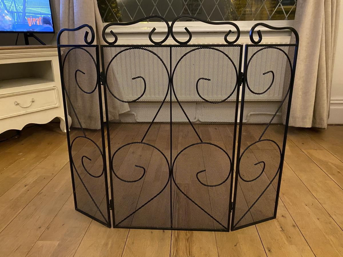 Beautiful black ornamental fireguard. Very solid and lovely design. Only selling as no longer have use for it.