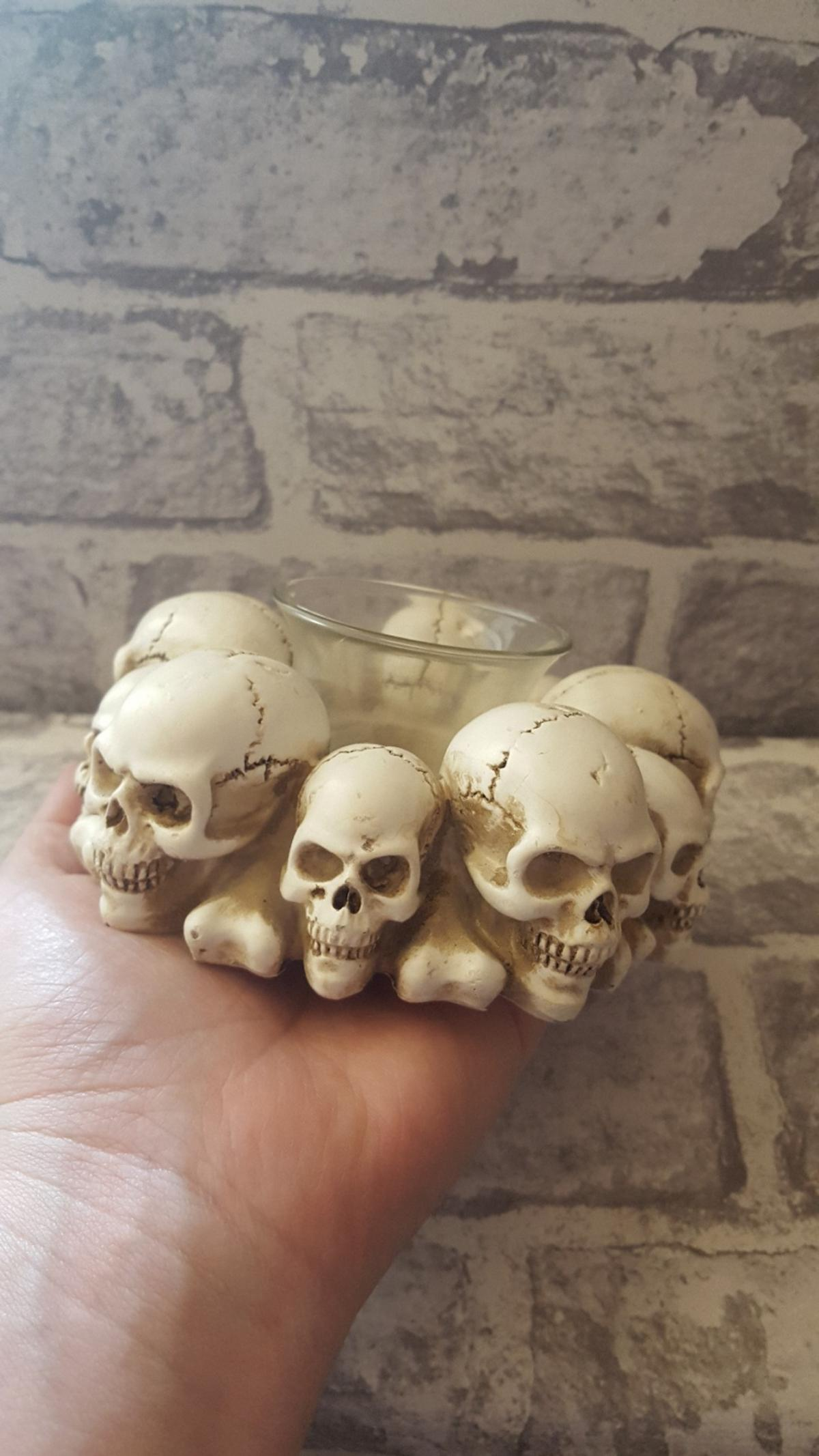 💀🔥Skull Tealight Candle Holder 🔥💀  Made from high quality sculpting resin with a glass tealight holder in the centre.  Height: 5.5cm Width: 13cm Depth: 13cm Weight: 0.36kg  £8.50 Collection Marston Green B37 £4 UK p&p etc  More than 1 Currently Available  BRAND NEW IN BOX WILL NOT KEEP ON HOLD NO OFFERS - I won't respond