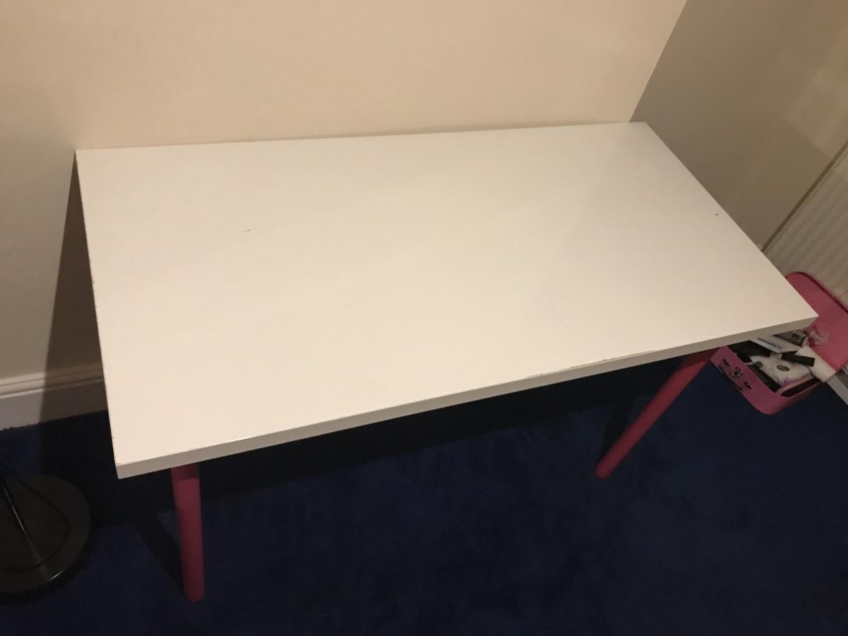 47.7 L x 24 w x 29 h inches White table with 4 pink removable legs