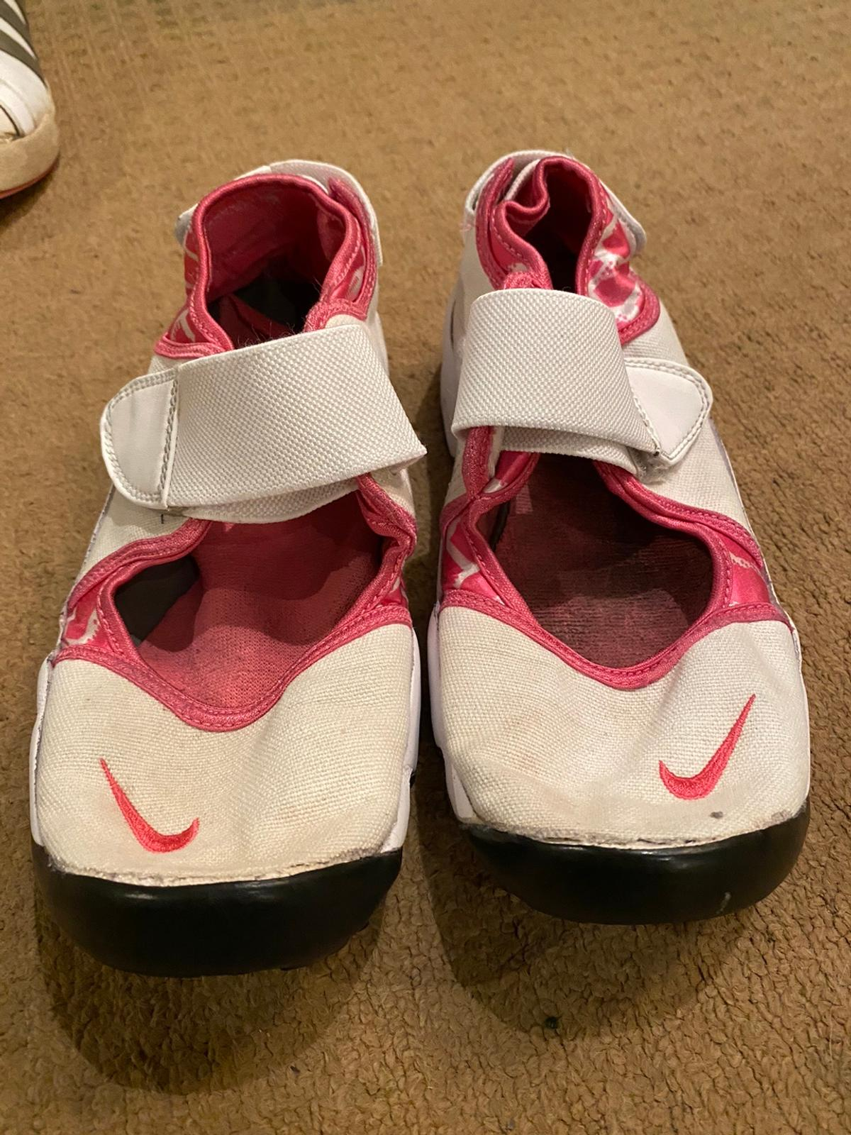 Nike size uk5.5 , white and pink. Velcro fastening. Worn but still plenty of life left in them.