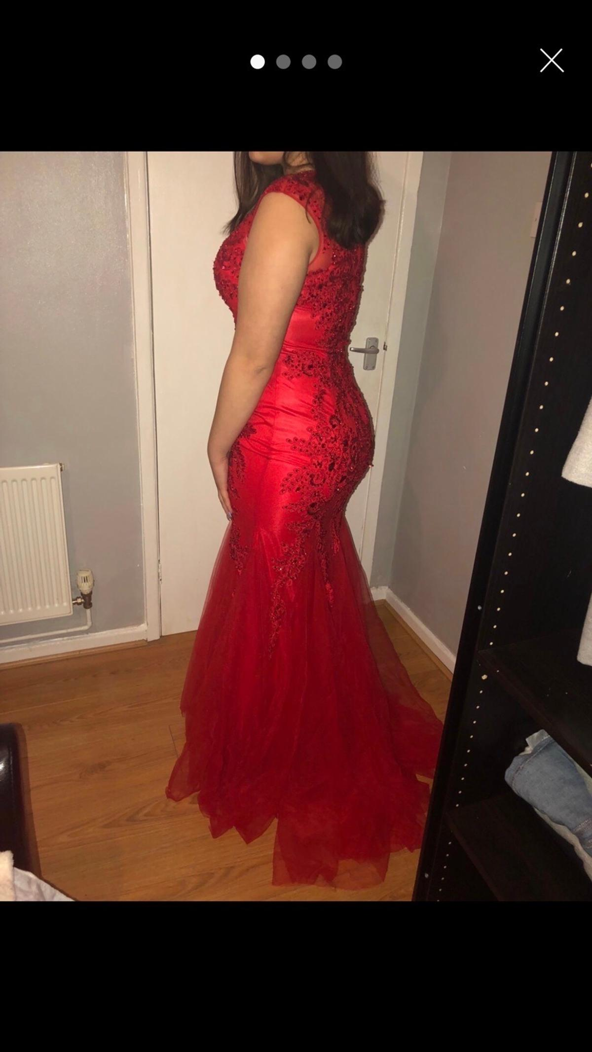 beautiful, high end, sequinned, red fishtail prom dress RRP £550 bought from sonique in birmingham size 12-14 worn once for a few hours open to reasonable offers