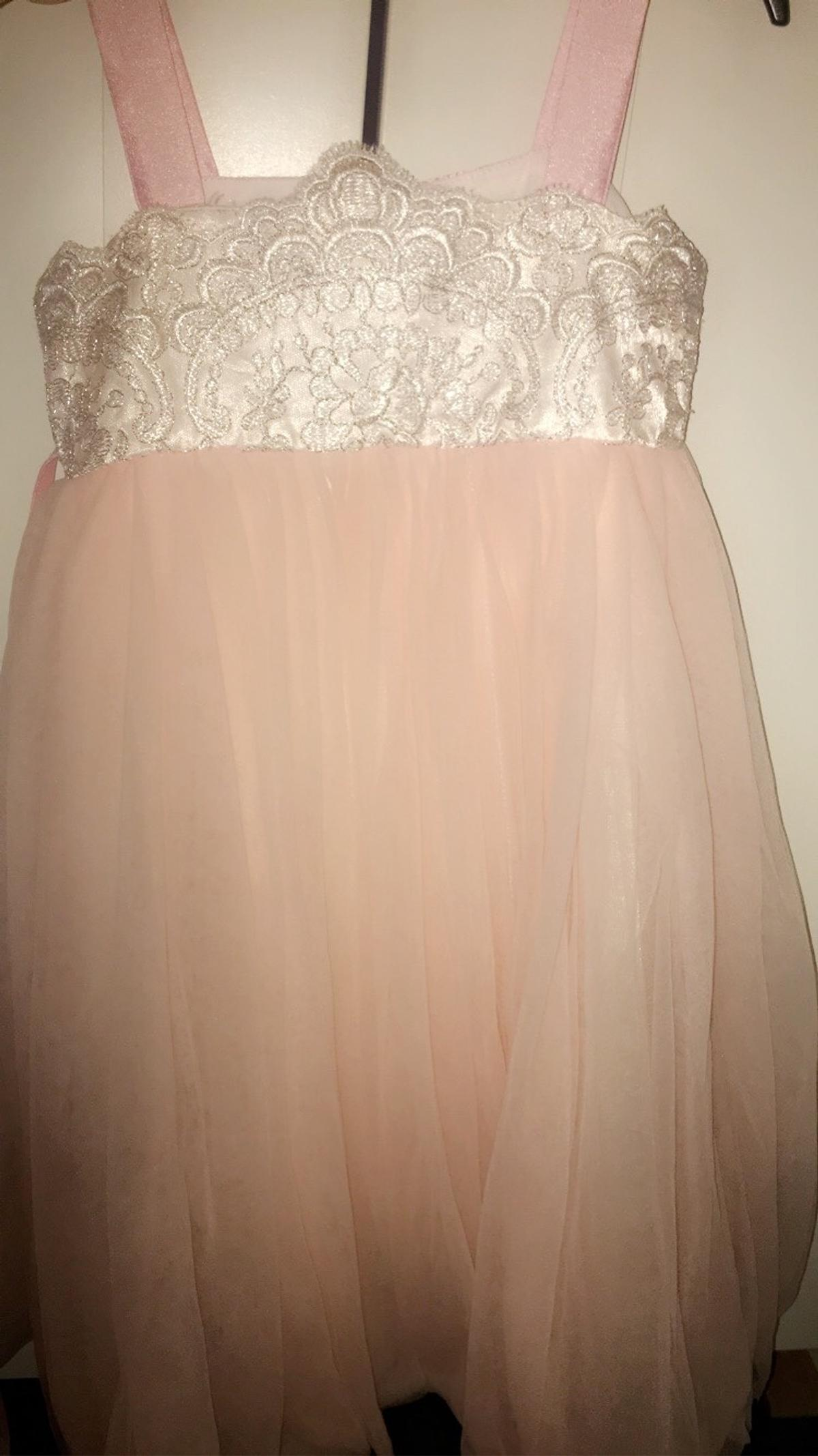 A lovely pink dress;Size 28 Age 4-6. Worn once