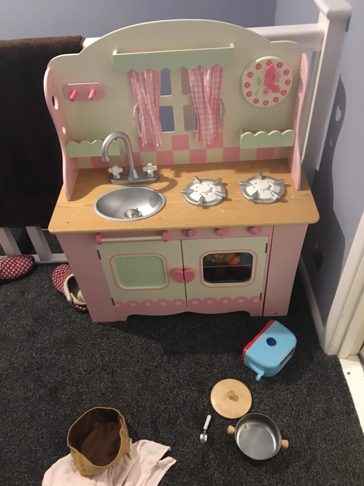 Wooden kitchen, oven, cupboard, sink and hob Used and some markings see photo.  Will throw in pots, pans utensils  From pet and smoke free home  Collection NN2