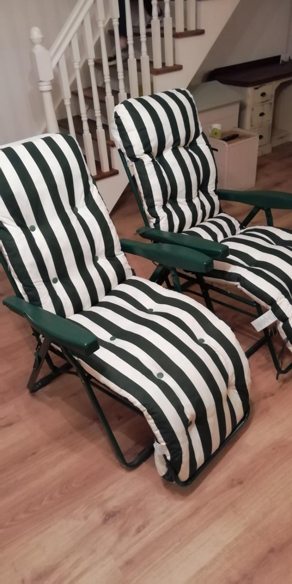 Two green and white garden reclining chairs as new condition very comfortable