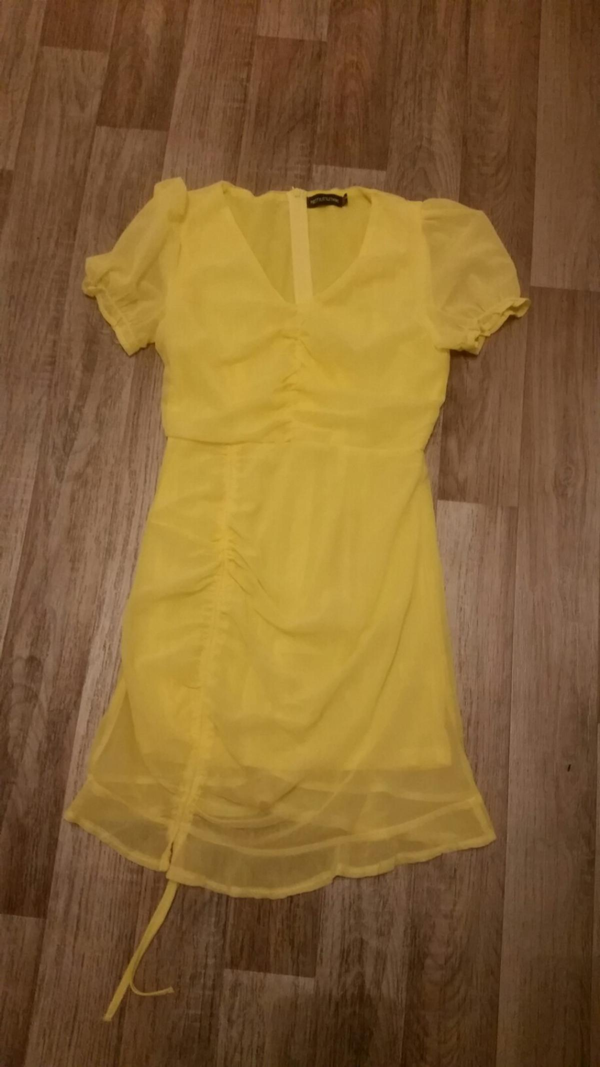 New never worn lovely ruffle dress.size 8.pick up only