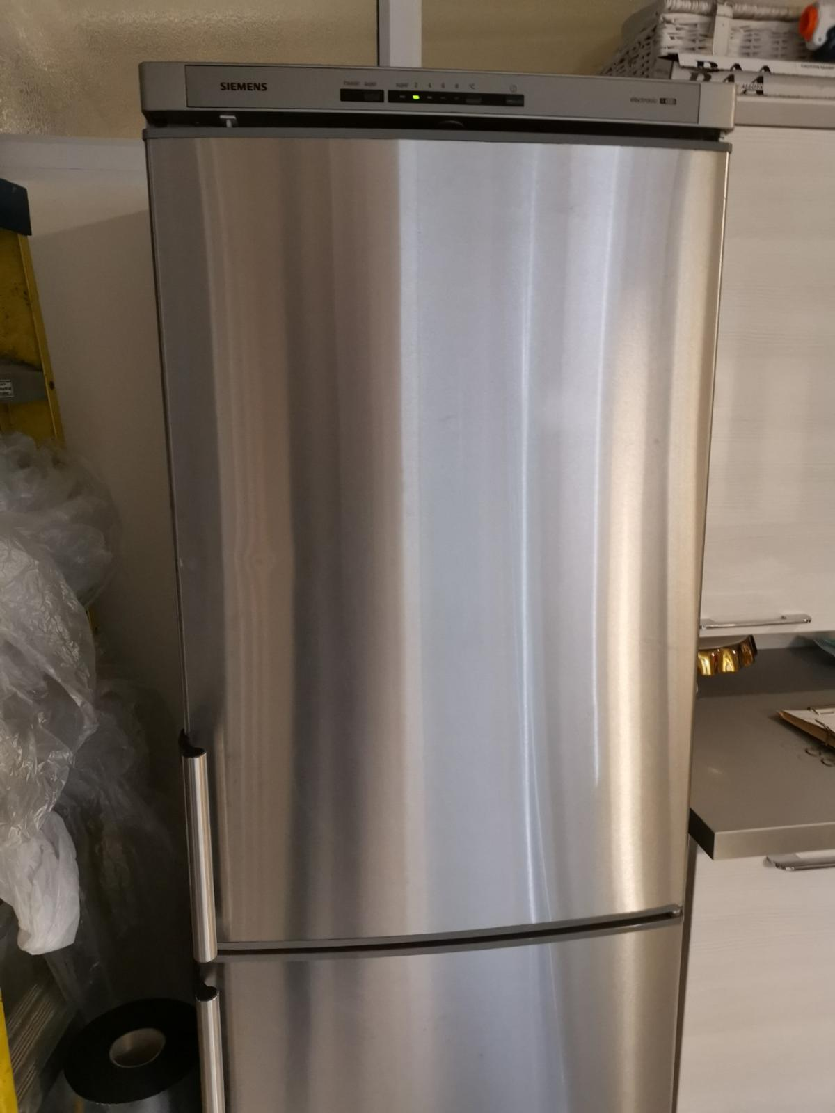 Gorgeous stainless steel fridge freezer. Perfect working order but 2 small dents to front, crack to side of freezer door edging. Plastic freezer drawers both damaged but can we used without. Open to offers as quick sale required.