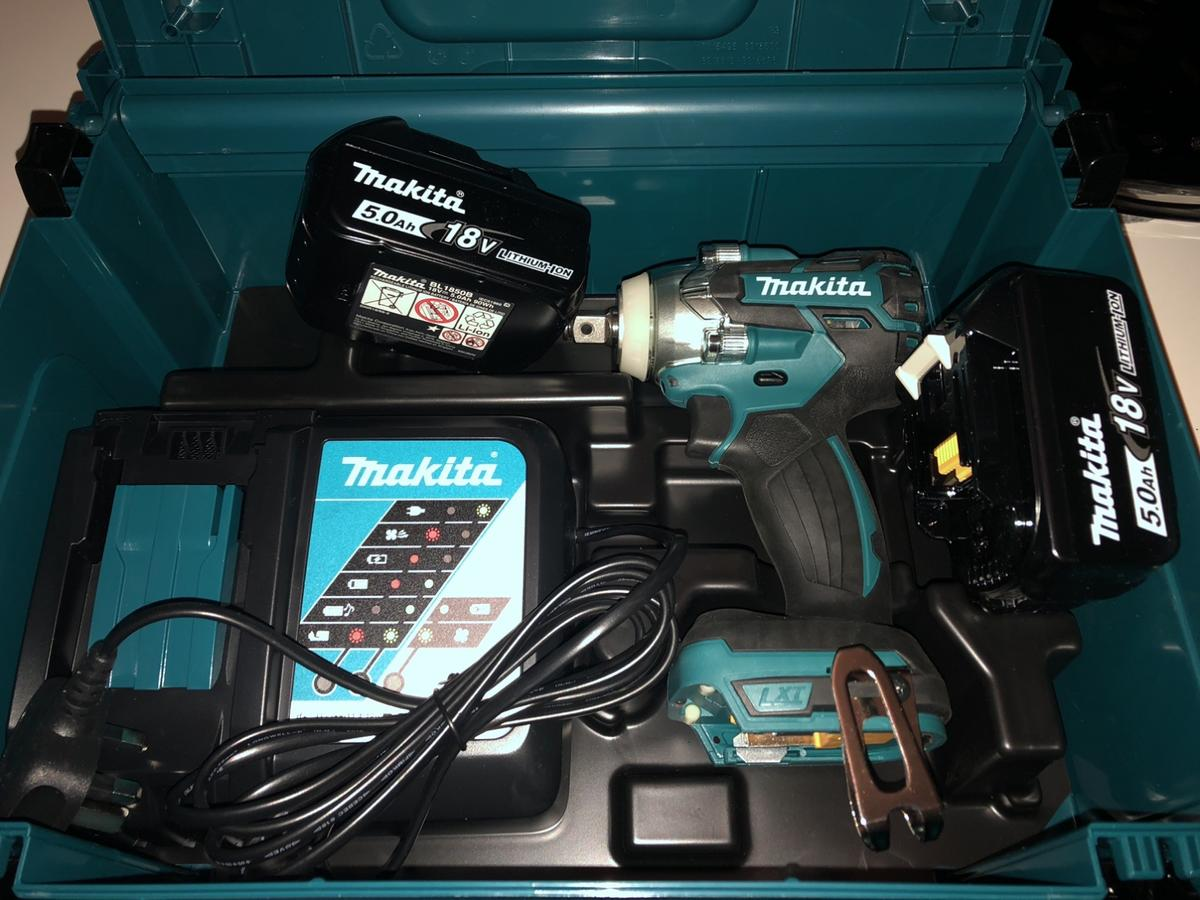 Makita DTW251Z impact wrench •• brand new never used ••  With - 2 x Makita 5.0Ah batteries 1 x Makita DC18RC charger 1 x Makita MacPak case All information & warranty details inc