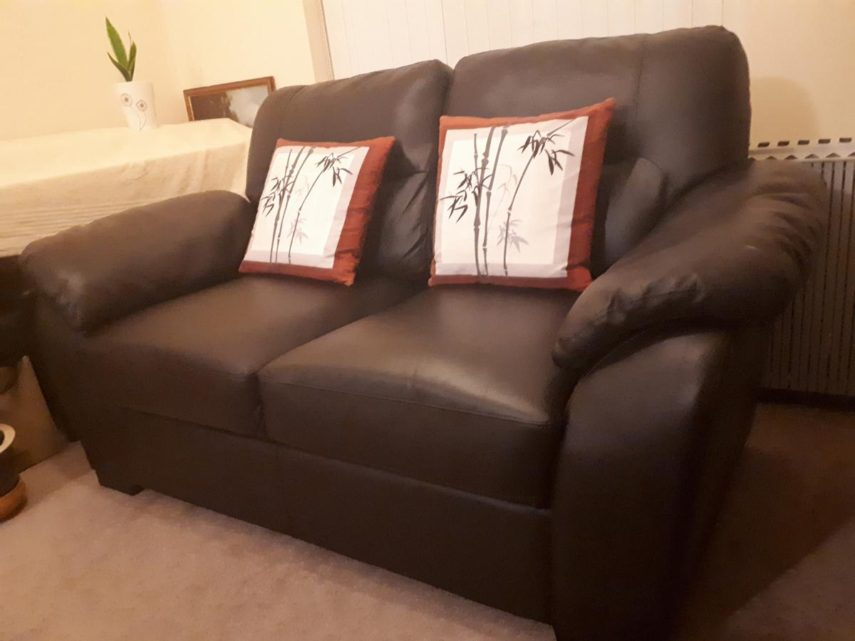 2 seater Soft Leather Sofa Dark Chocolate Brown. Appox size: L 163cm X W 90cm X H 88cm. Delivery can be arranged with a small charge. If you are interested, please call me 077424 84622.