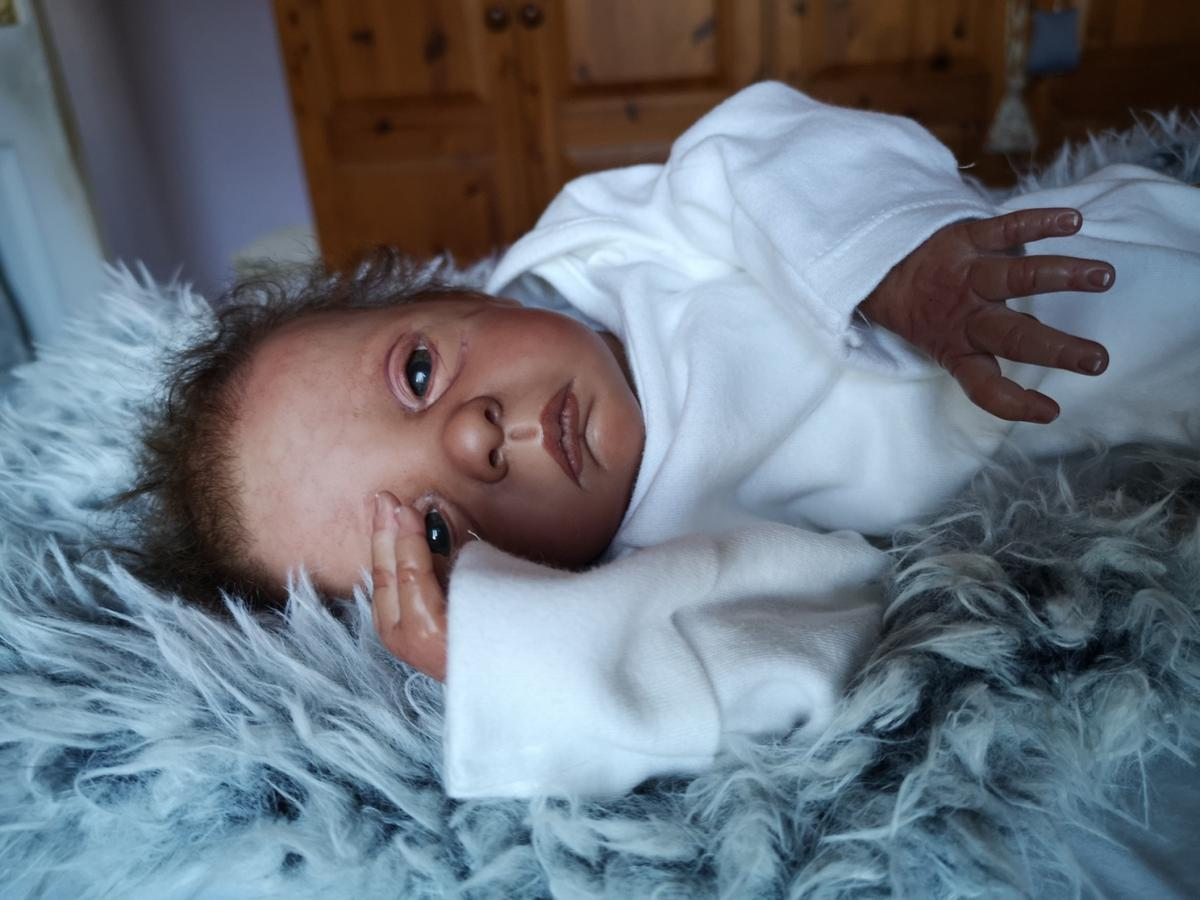 """a gorgeous biracial baby girl from the """"Julie""""sculpt by Evalina Wosnjuk.....excellent condition and a long sold out sculpt. Baby is approximately 17"""" long ,weighs around 4 lbs and has lovely full limbs. She has the most adorable expression ,,her eyes look right at you😍She has a magnet for her dummy and one for a hair decoration and also a tummy plate.she wilk come with a vest,blanket,babygrow and a dress. she is really superb."""