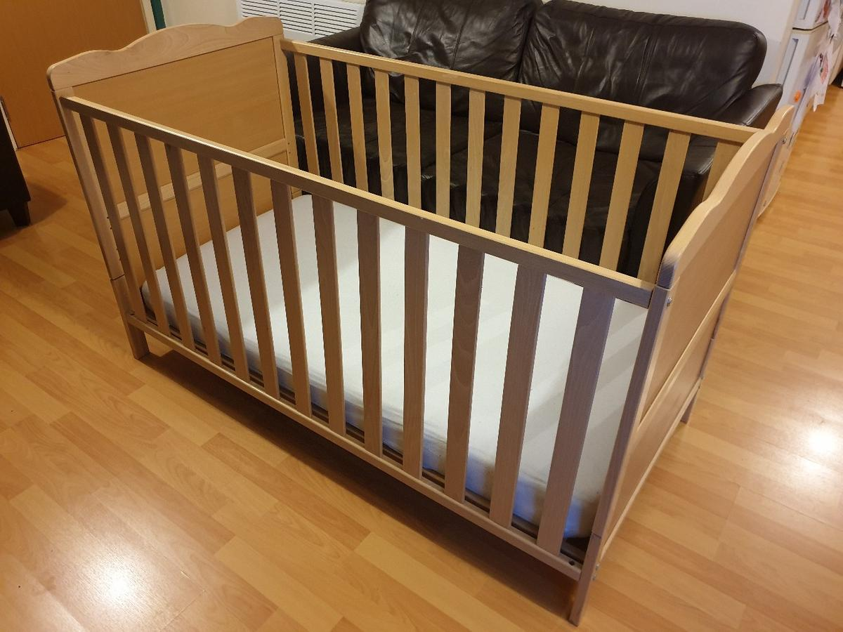 Good Condition with mattress.  Only used for our one son and always had a mattress topper. Pic 1 and 2 are as a cot, and 8 bolts simply unscrew the sides to turn into a bed (pic 3).  Very solid and easy to assemble.