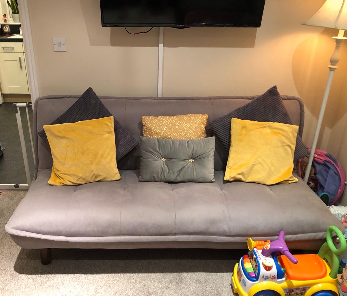 Grey sofa bed  folds back to a bed  Only sell as Got new sofa and can't fit them both in the room  message for any info  £70 o.n.o