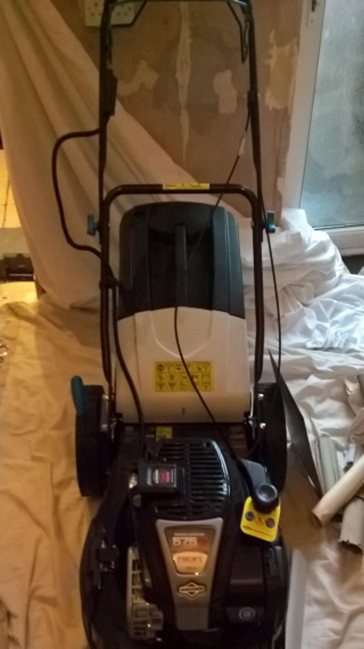 A Brand new self propelled lawnmower with self start technology RRP: £335 I want £200. Still in box..That is over a £100 Saving  Pics are of build from new in box to complete. It fully works and charges, excuse the room I am decorating  This MAC MLMP575SP46 self-propelled petrol lawnmower is ideal for large lawns (up to 1000 m²).  Cutting width 460mm, 10 cutting heights Collection capacity 60L Briggs & Stratton 575 iS 4-stroke 2200 W Petrol 3 in 1 function Plastic and fabric collection bag
