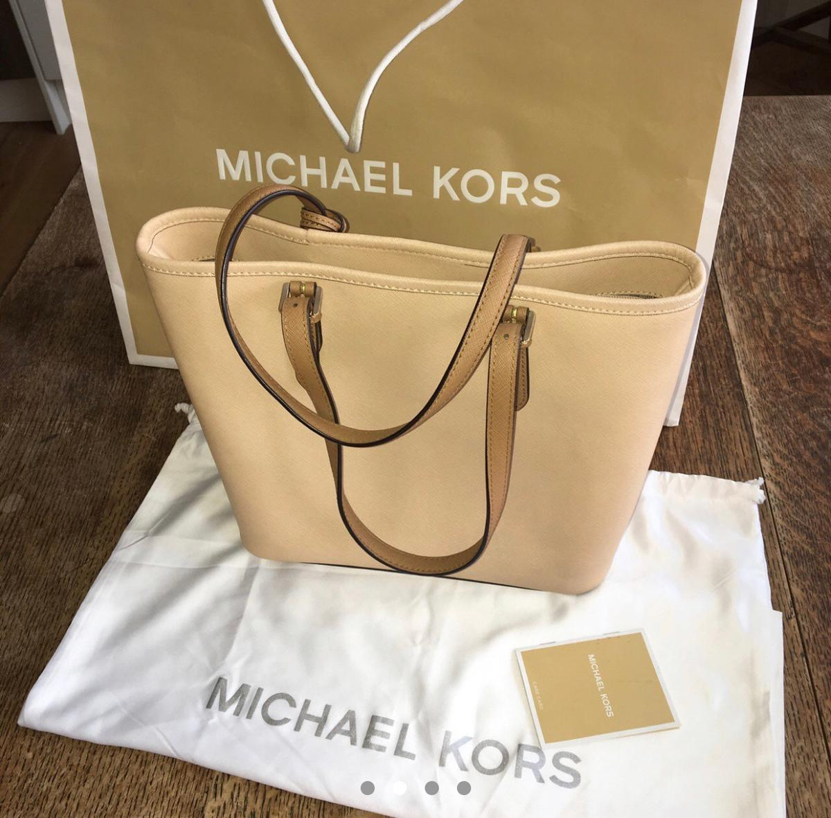 Authentic Beige-cream- brown Michael Kors bag Used about 4 times