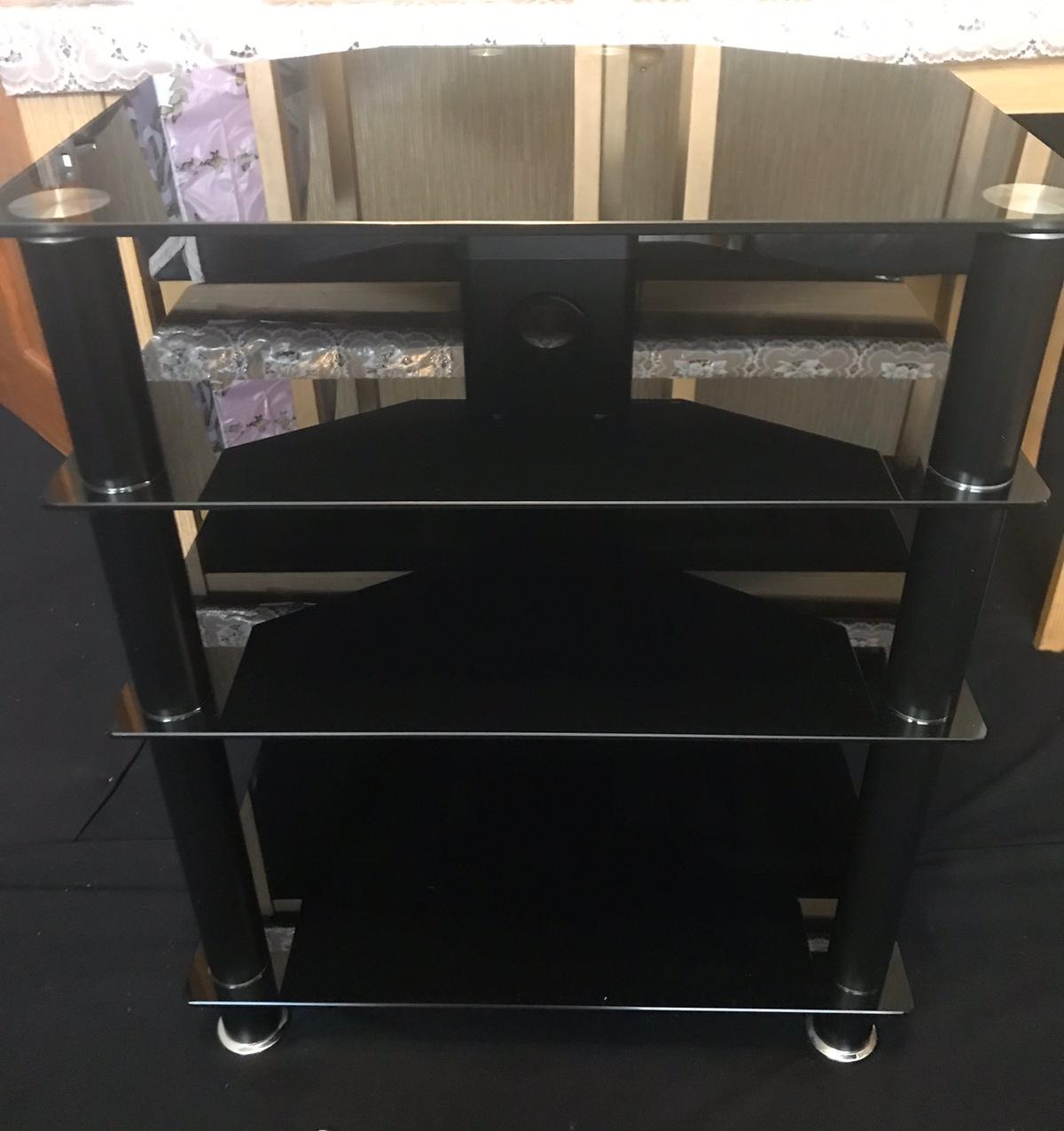 Black glass tv stand / hi-fi /console etc stand In good condition few scratches but not really visible fully assembled collection only ONO