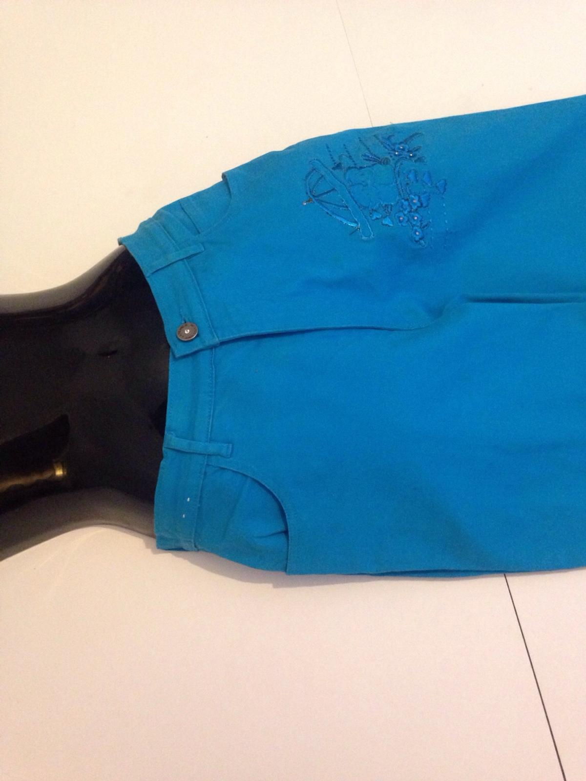 Blue jeans embroiled at the legs. Size 14 Collection. P&P at additional charge.
