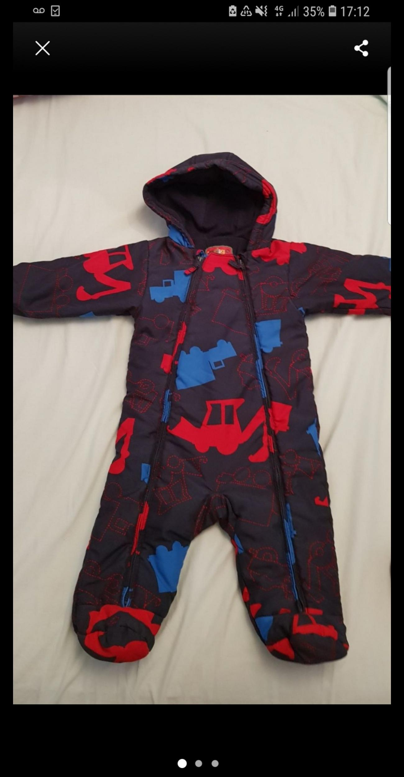 Padded, with fleece lining snowsuit/pramsuit for baby boys 6-9m. unfortunately mitts are missins. From TU Sainsbury's.  Collection from East London( Leyton E10)