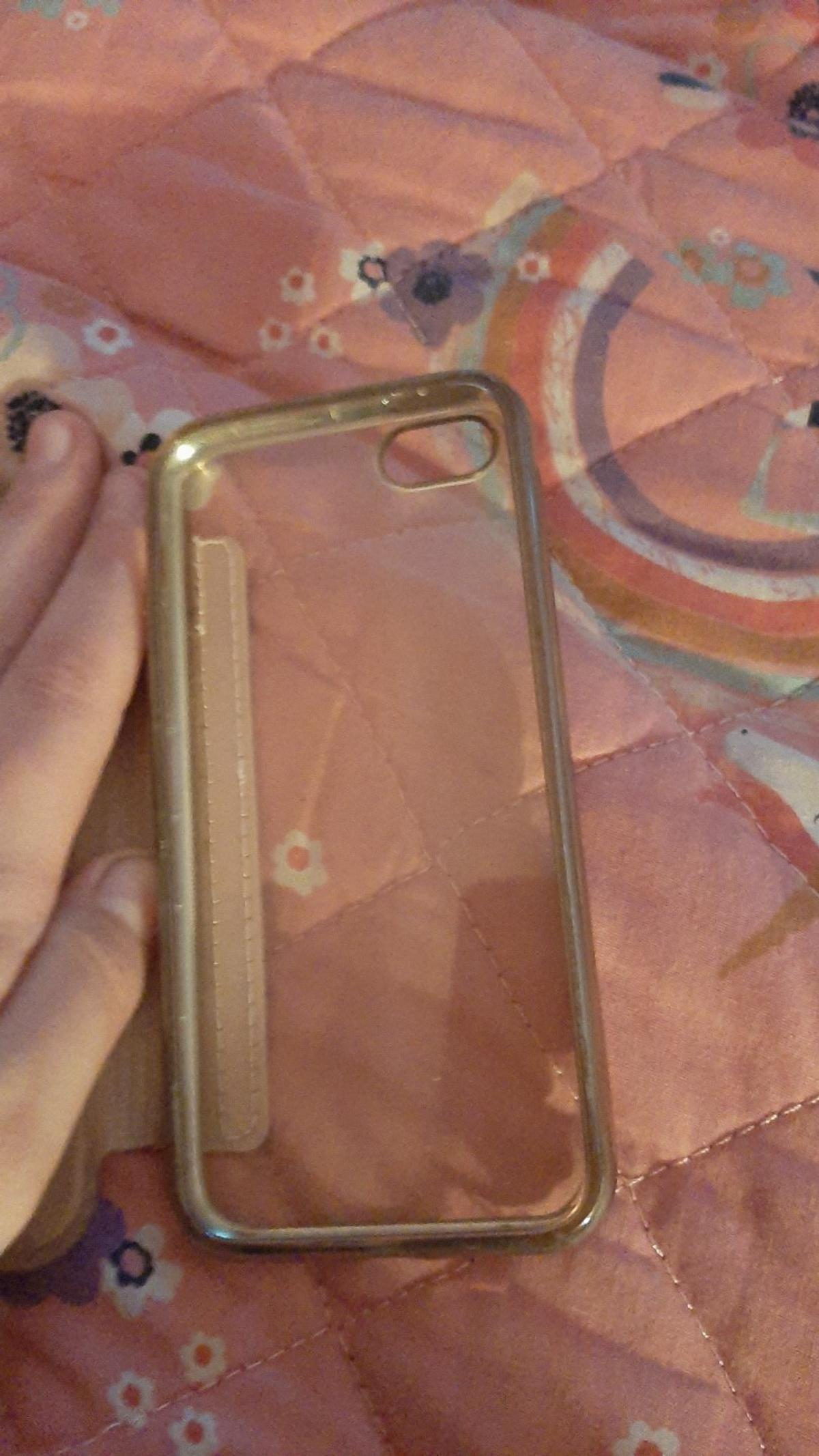 has a credit card space light pink and has a see through back