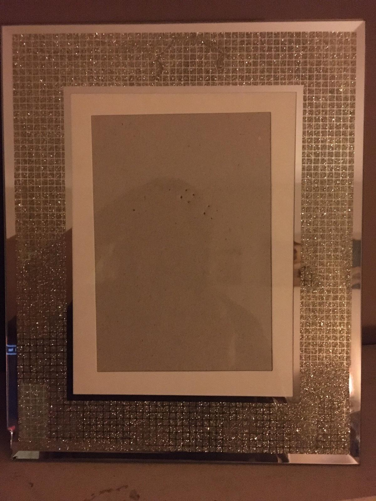 2 photo frames. 1 is slightly chipped on the corner but it's hardly visible. Picture on to show.