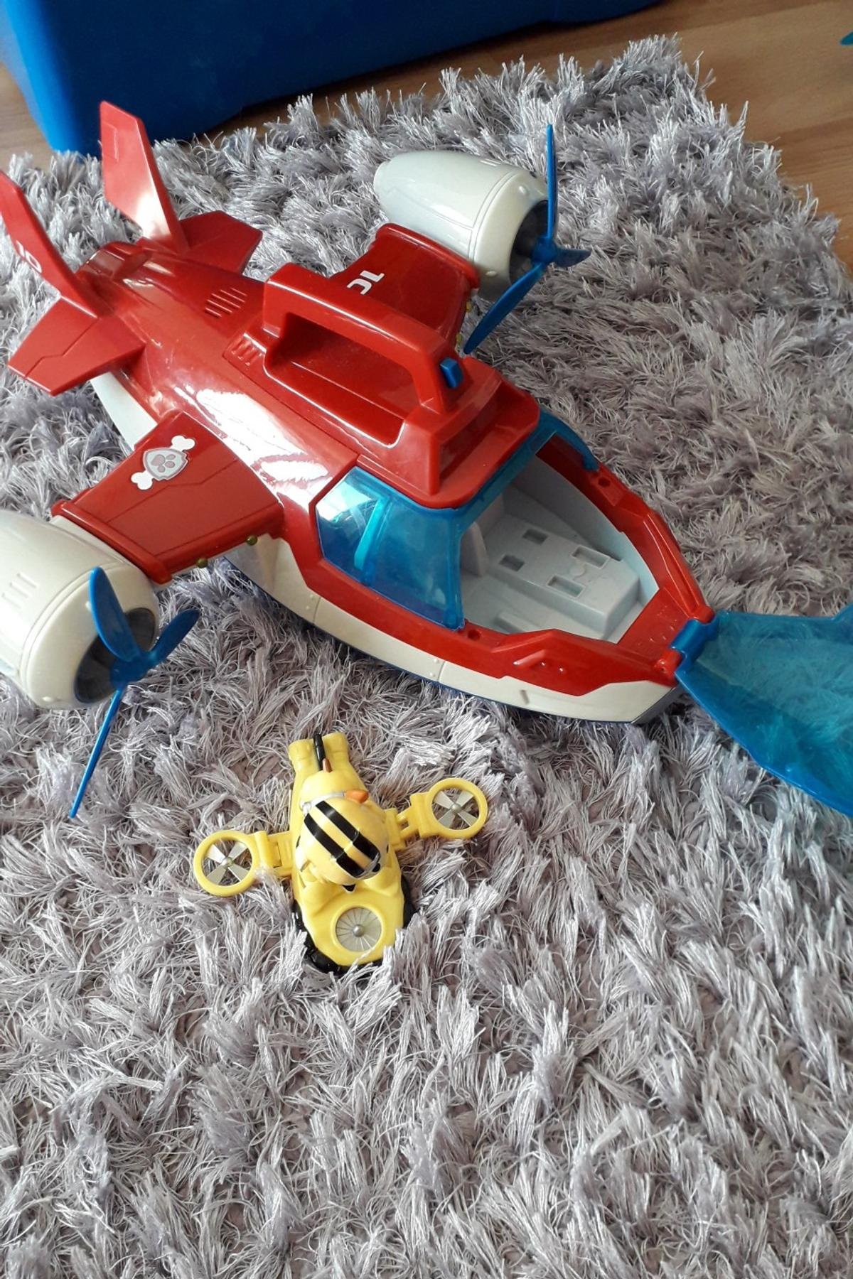 Air patroller with extra figure. Does have lights and sound but requires a new battery. From pet and smoke free home