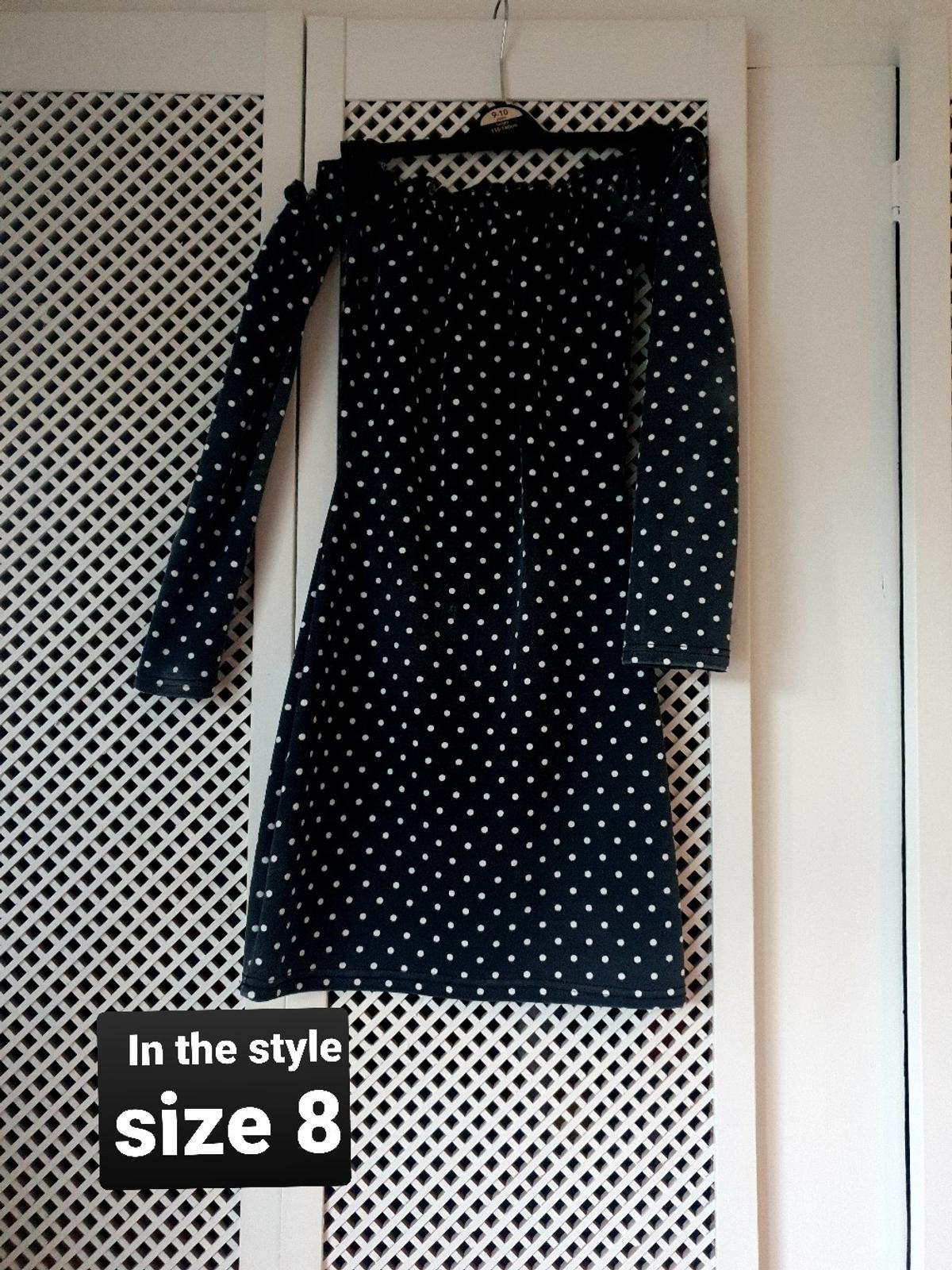 worn once. black and white spotty dress, black has faded more like a dark grey but in good condition.