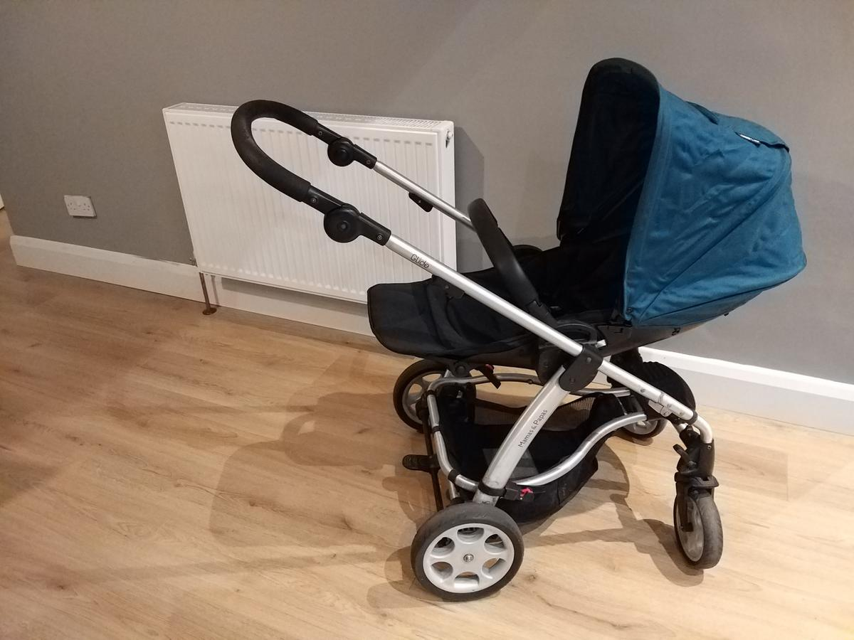 Mamas and papas glide. Complete buggy with rear and forward facing seat. The buggy has a new seat cover, hood, saftey straps and bar. It also has a spare hood and foot muff. Carrycot, sun umbrella, maxi cosi car seat adapters, maxi cosi car seat base, rain cover. Buggy is in excellent condition, smoke free home. Everything is included plus extras that I've added in (can be seen in the pictures)