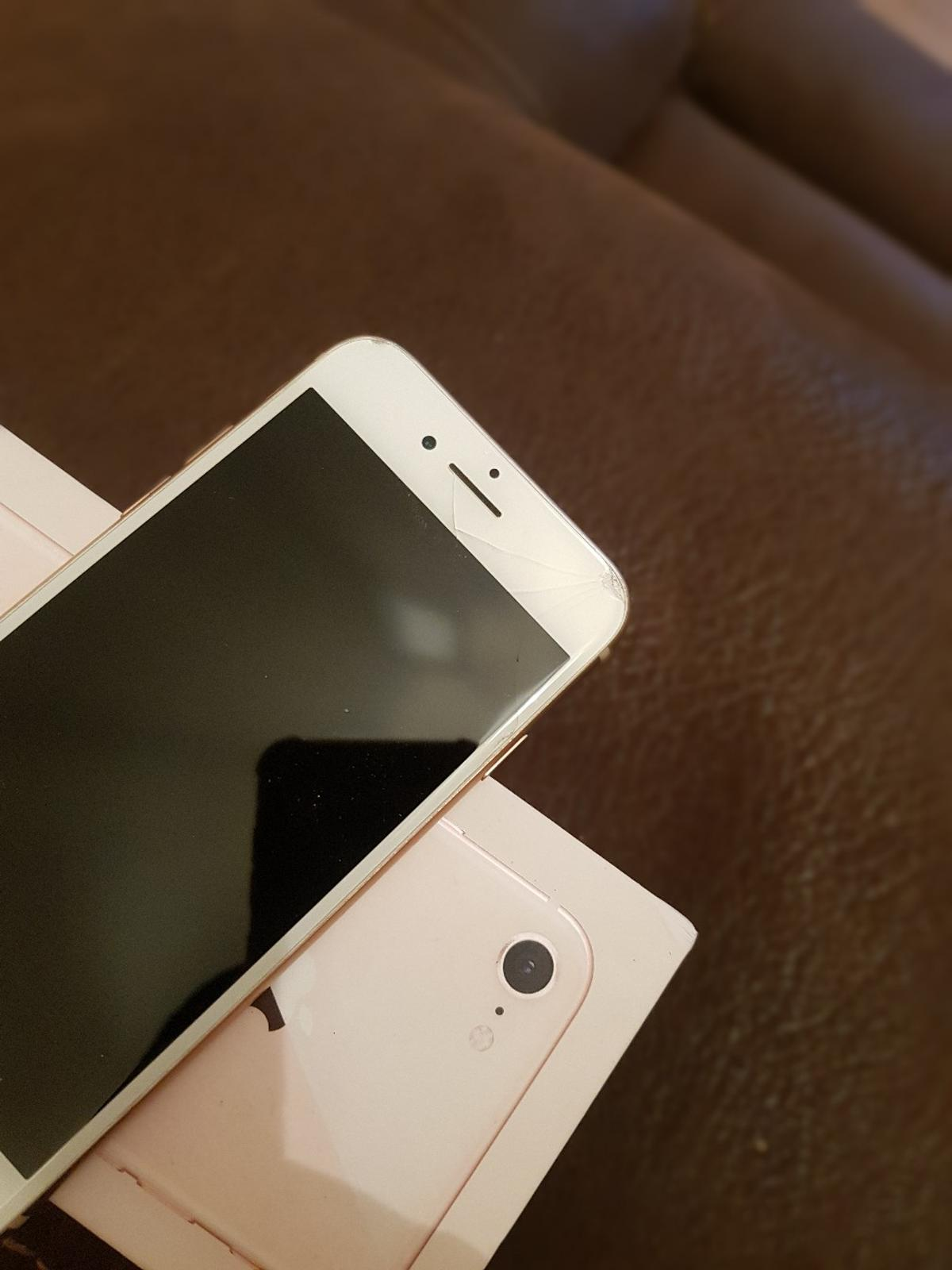 iphone 8 64gb in white and gold works on 02 and ee comes boxed with charger and earphone adapter...the phone has a small crack at top right of screen apart from that it is in excellent condition please see pics.
