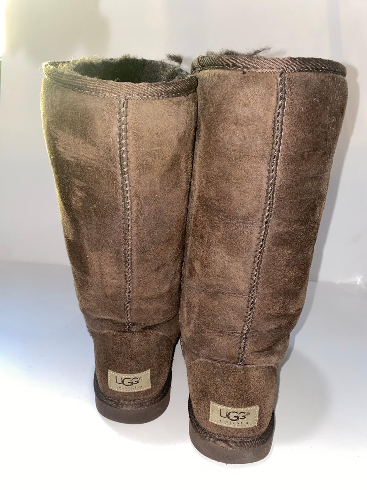 "UGG Classic Tall Boot, Size 8, Currently being sold retail, Pre-owned, Very Good Condition, Minor signs of wear shown in pictures with plenty of years of wear for your pleasure, Seams intact, interior fur is not matted, Rubber sole, suede leather and sheepskin fur interior; approximate height of boot shaft 11.75"". Ship only sales with payment made using PayPal."