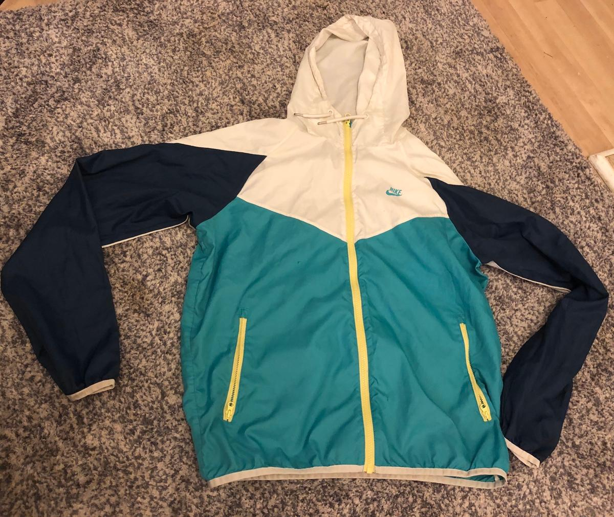Nike jacket , slight hole in hence free  Size medium