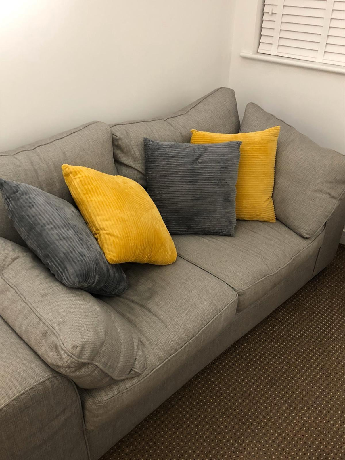 Lovely 2-3 seater grey fabric sofa in good condition , not including the colour cushions 200cm long 93 cm deep 77 cm high Free local delivery