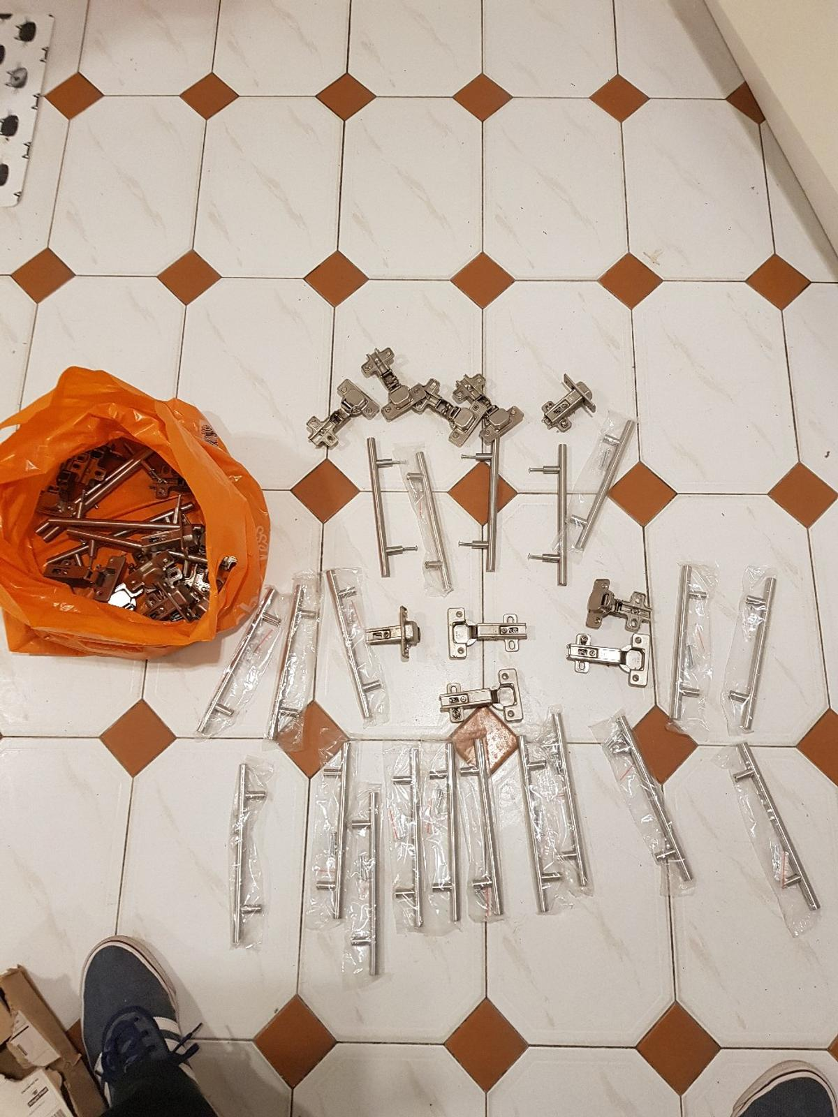 About 20 Brand new cupboard door handles. also some used same type. also about 15 pairs of hinges for same cupboards 20 pounds the lot