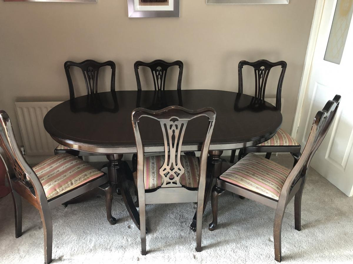 """Extending Dining table and six chairs, 5'1"""" extends to 8'6"""". Good condition Must go due to imminent building work All offers considered See other matching pieces Buyer would need to collect"""