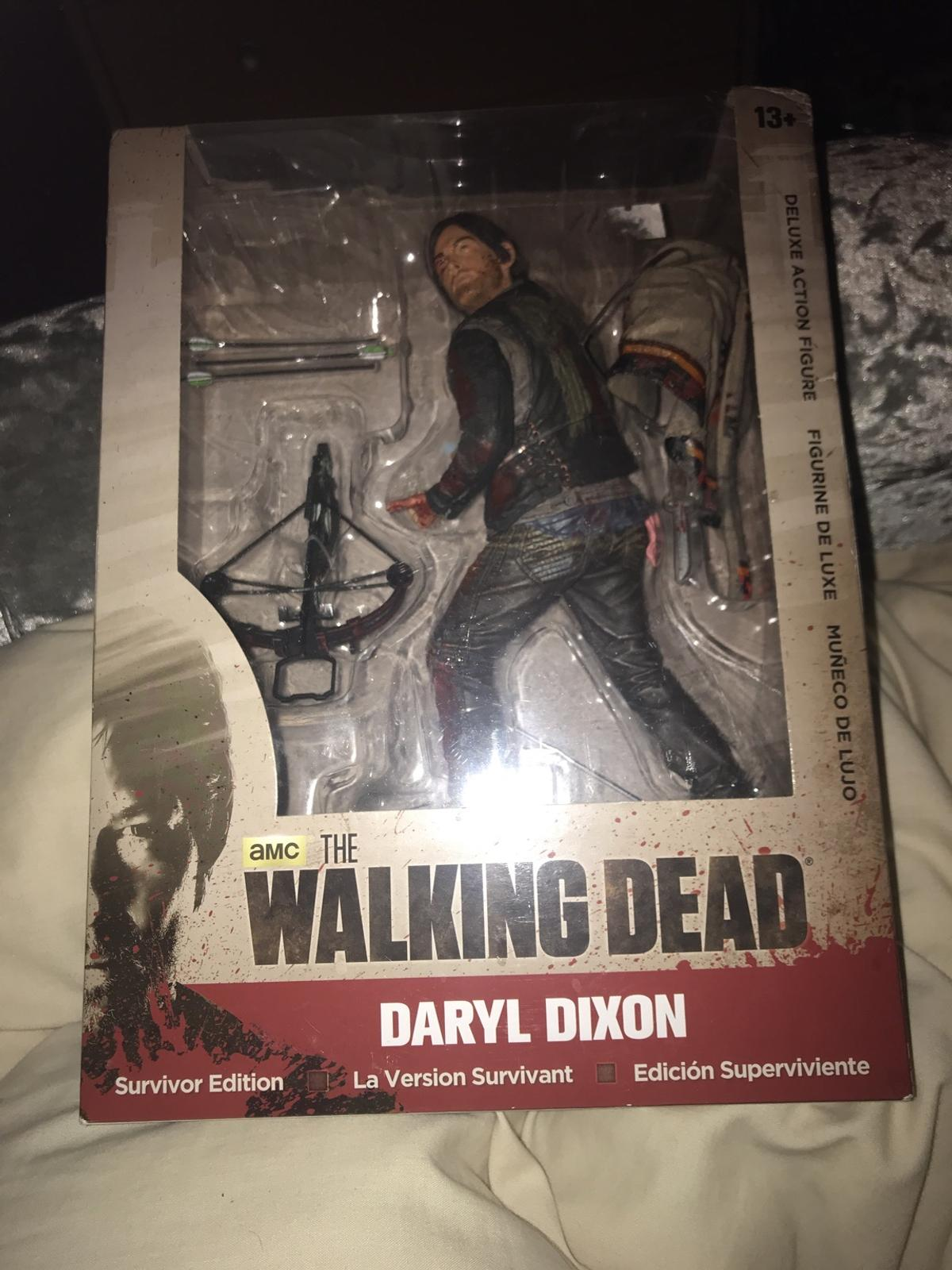 The walking dead survivor edition deluxe figure never been opened box is slightly damaged at the top nothing serious