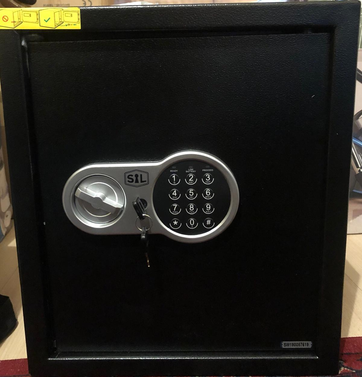 Brand New Digital Safe In Black With 2 Keys & Instructional Manual. 1 back top corner was bent because of wrong lifting. Showing in photos
