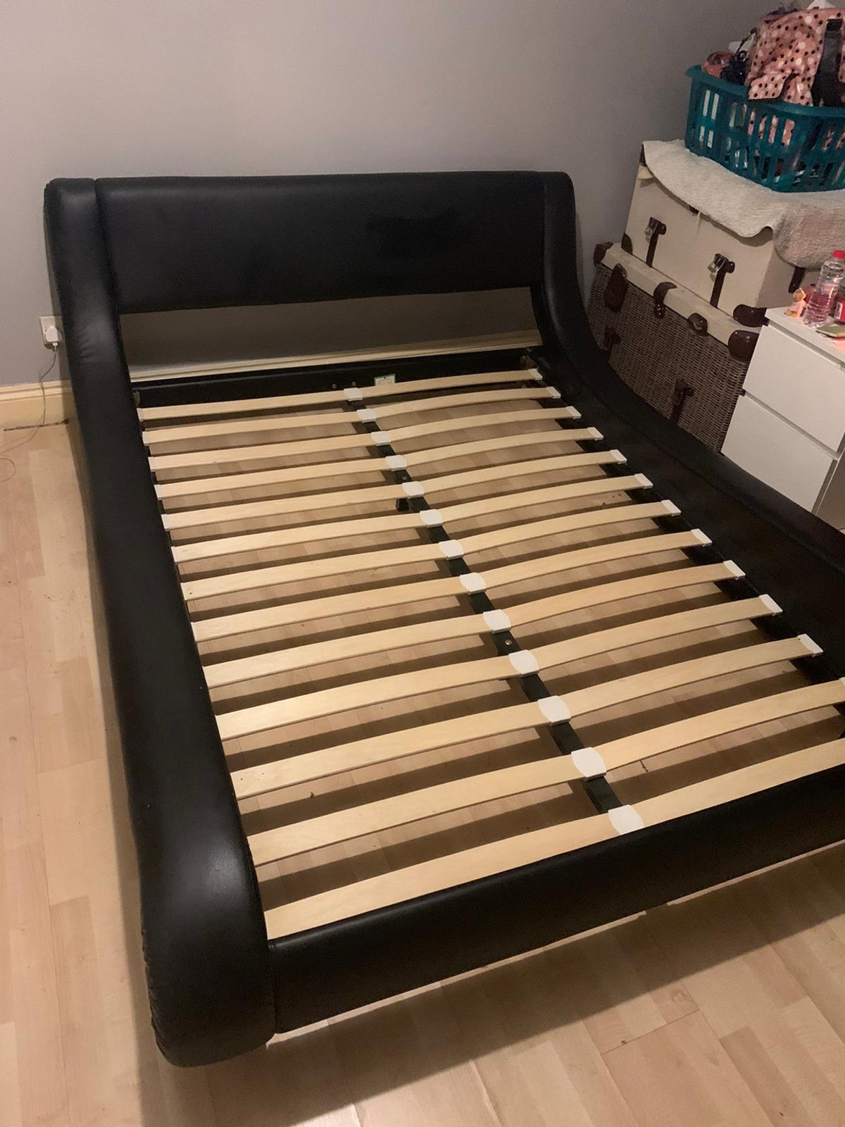 Black double bed frame  Will be taken apart ready for you to collect as I need to get my new bed in. Collection only  2 years old good condition - minimal marks but wear n tear is reflected in price